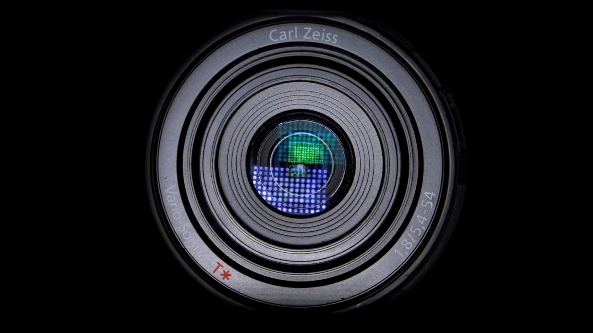 Camera lens & light reflection in lens on black background ...