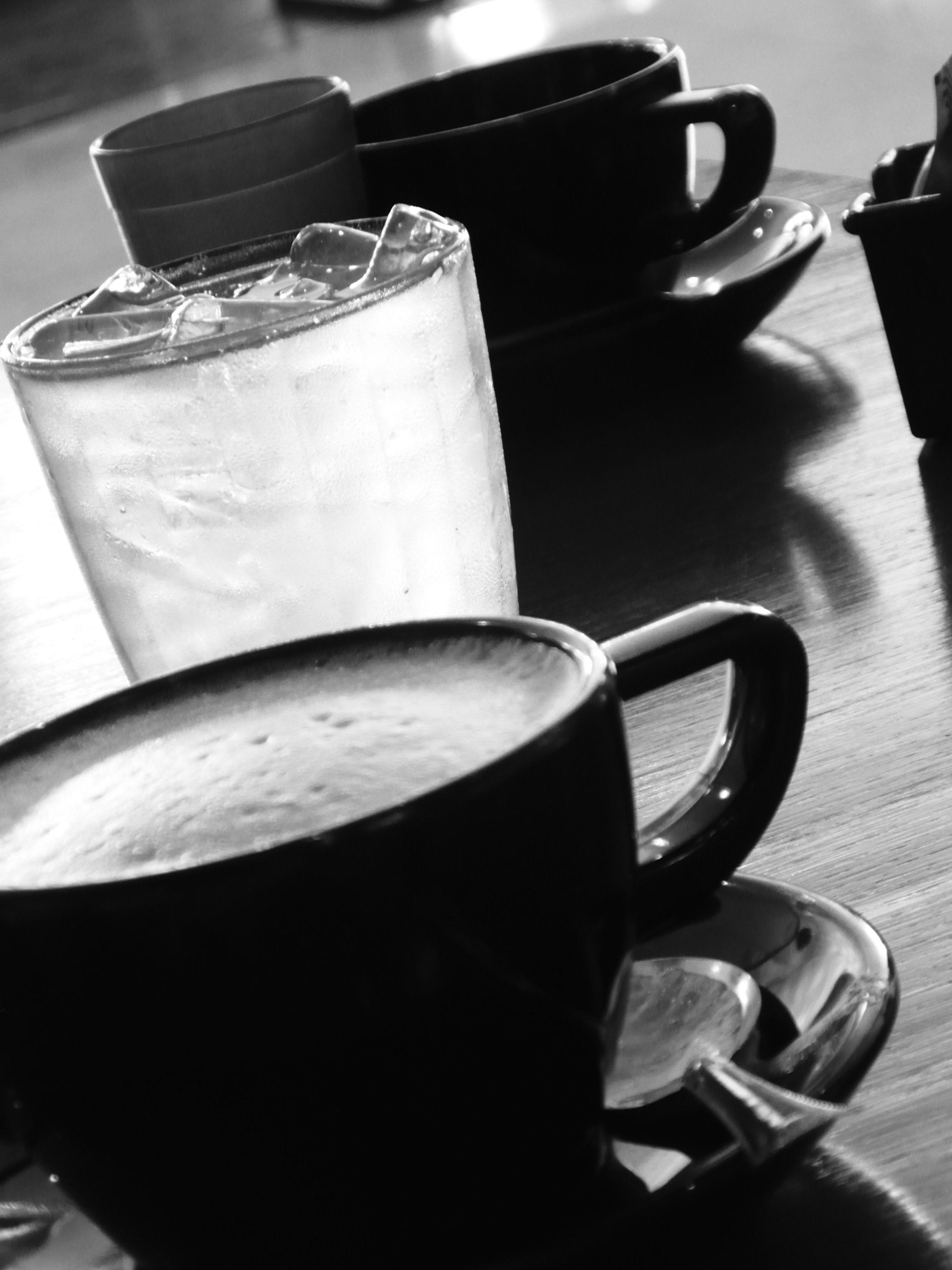 Black coffee cups b&w image photo