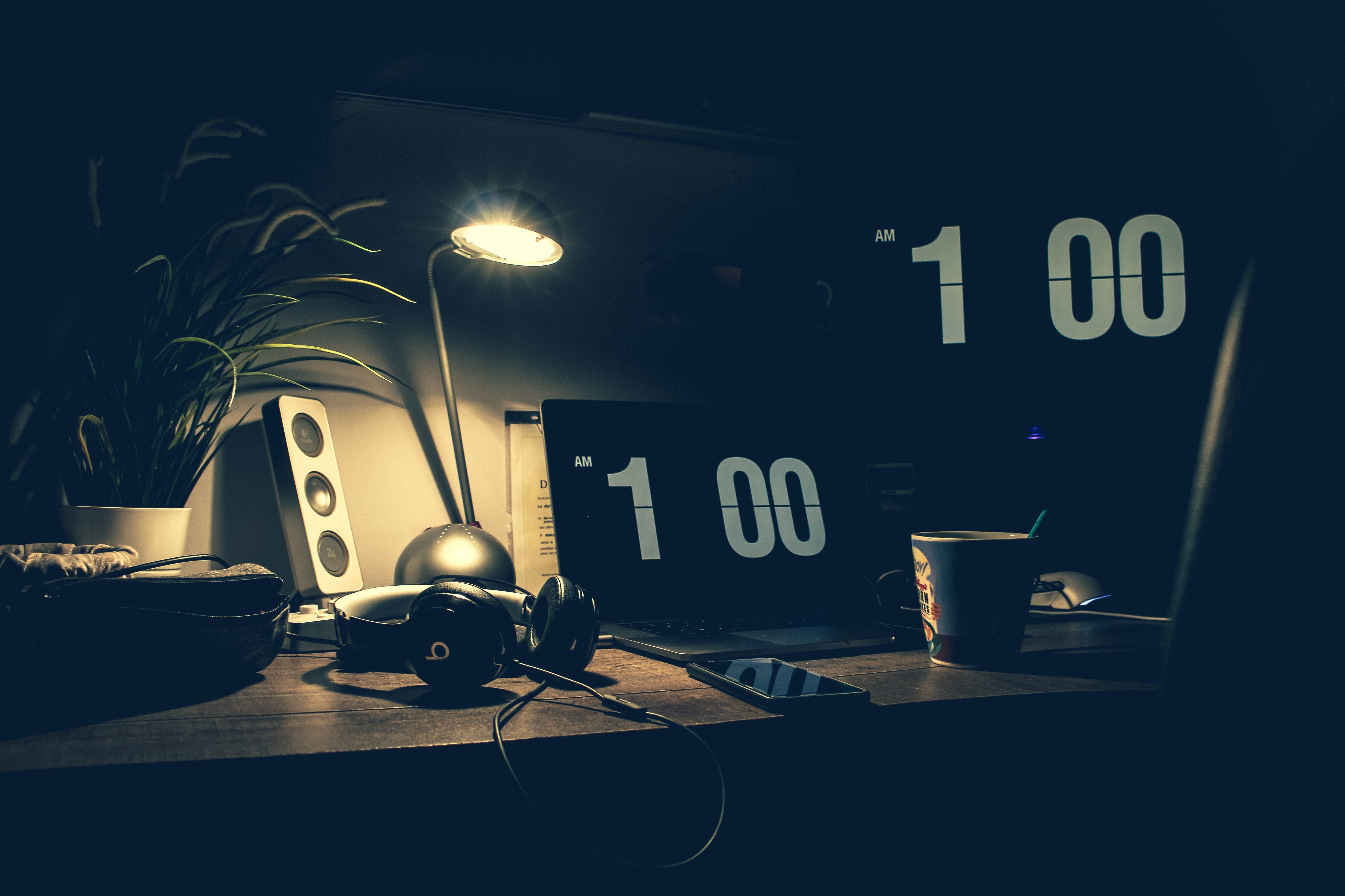 Black digital alarm clock at 1:00 photo