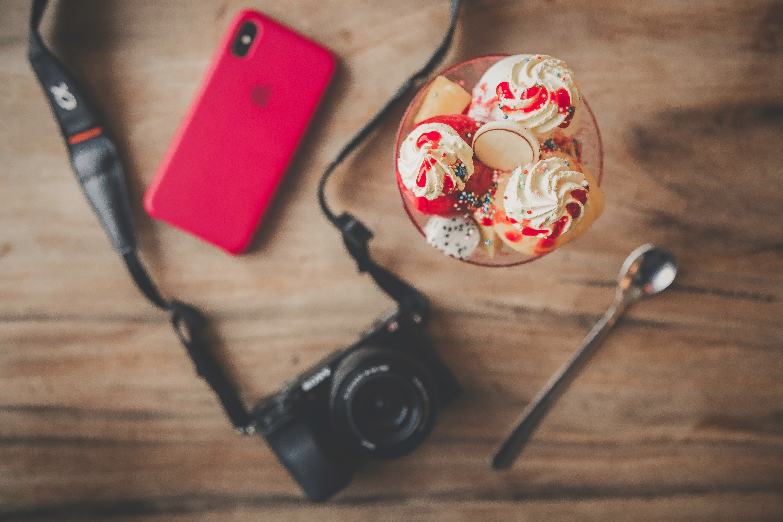 Free Photo Black Dslr Camera Teaspoon Ice Cream And Iphone X
