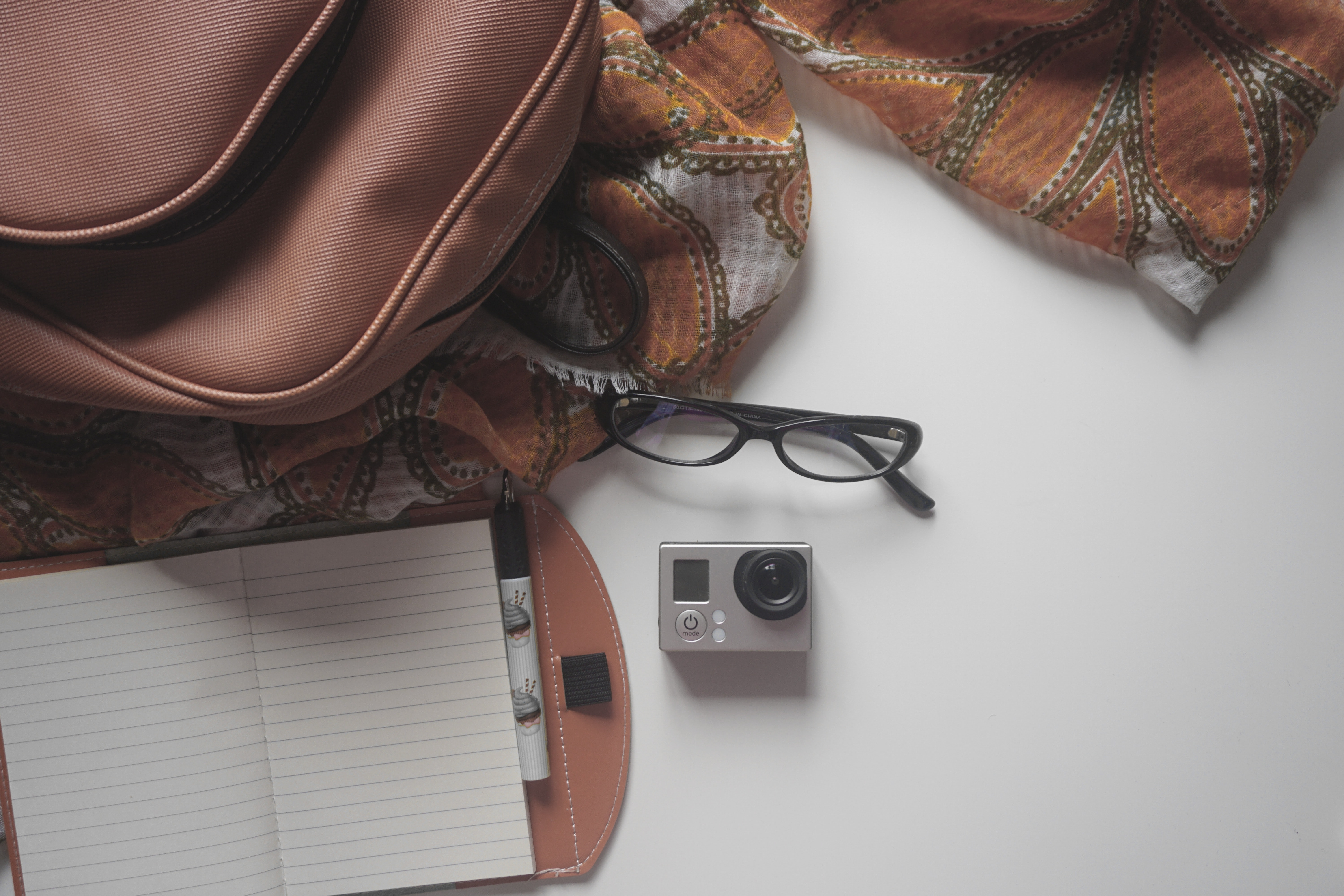 Black Eyeglasses on Top of the Gray and Black Action Camera in the White Surface, Accessories, Bag, Camera, Eyeglasses, HQ Photo