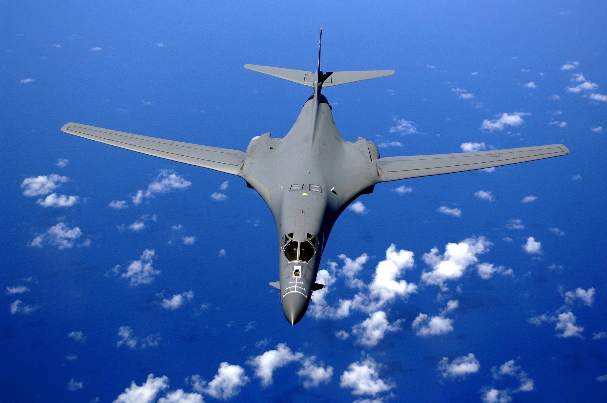 Black fighter jet near white clouds photo