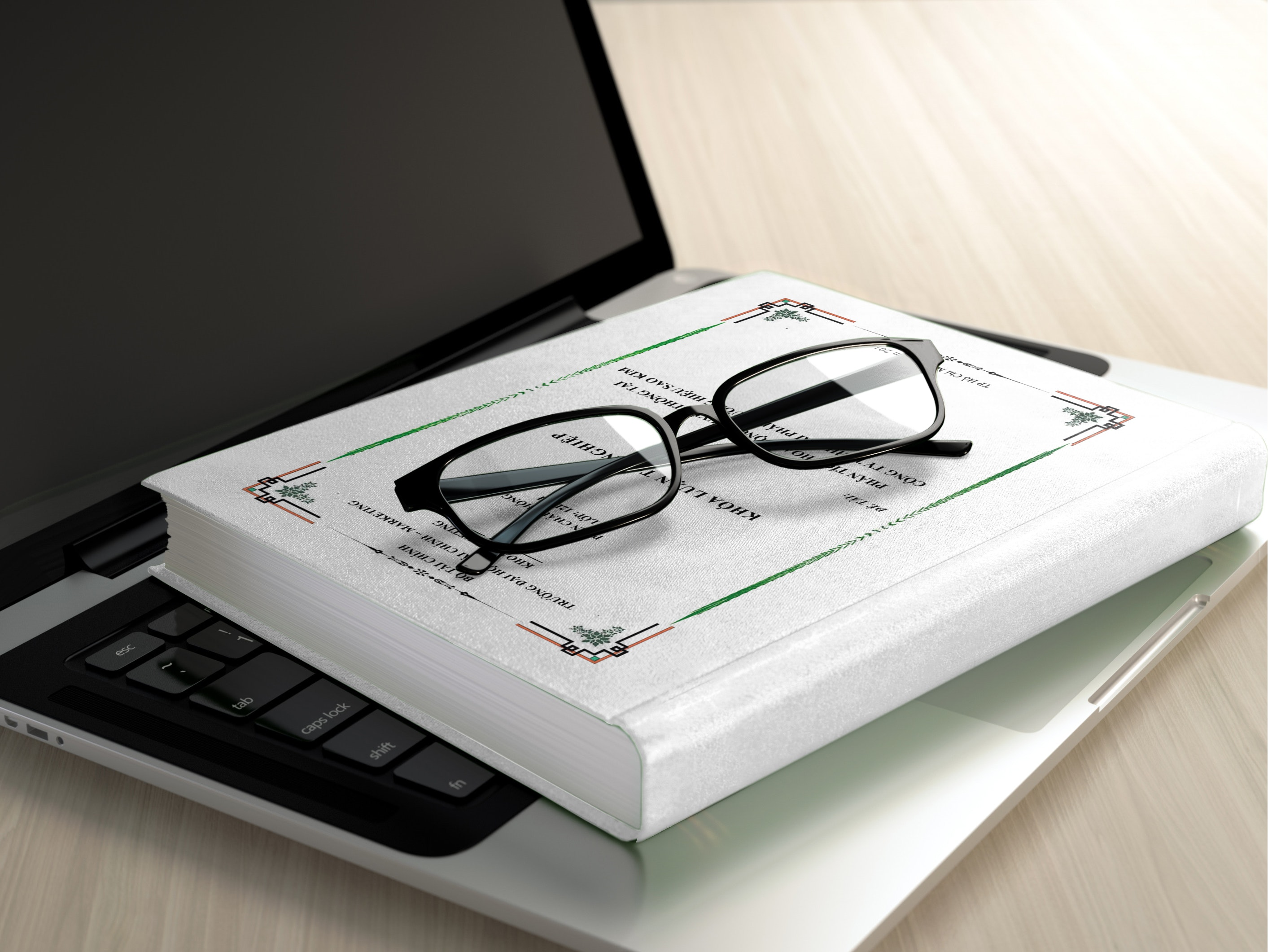 Black frame eyeglasses on white book photo
