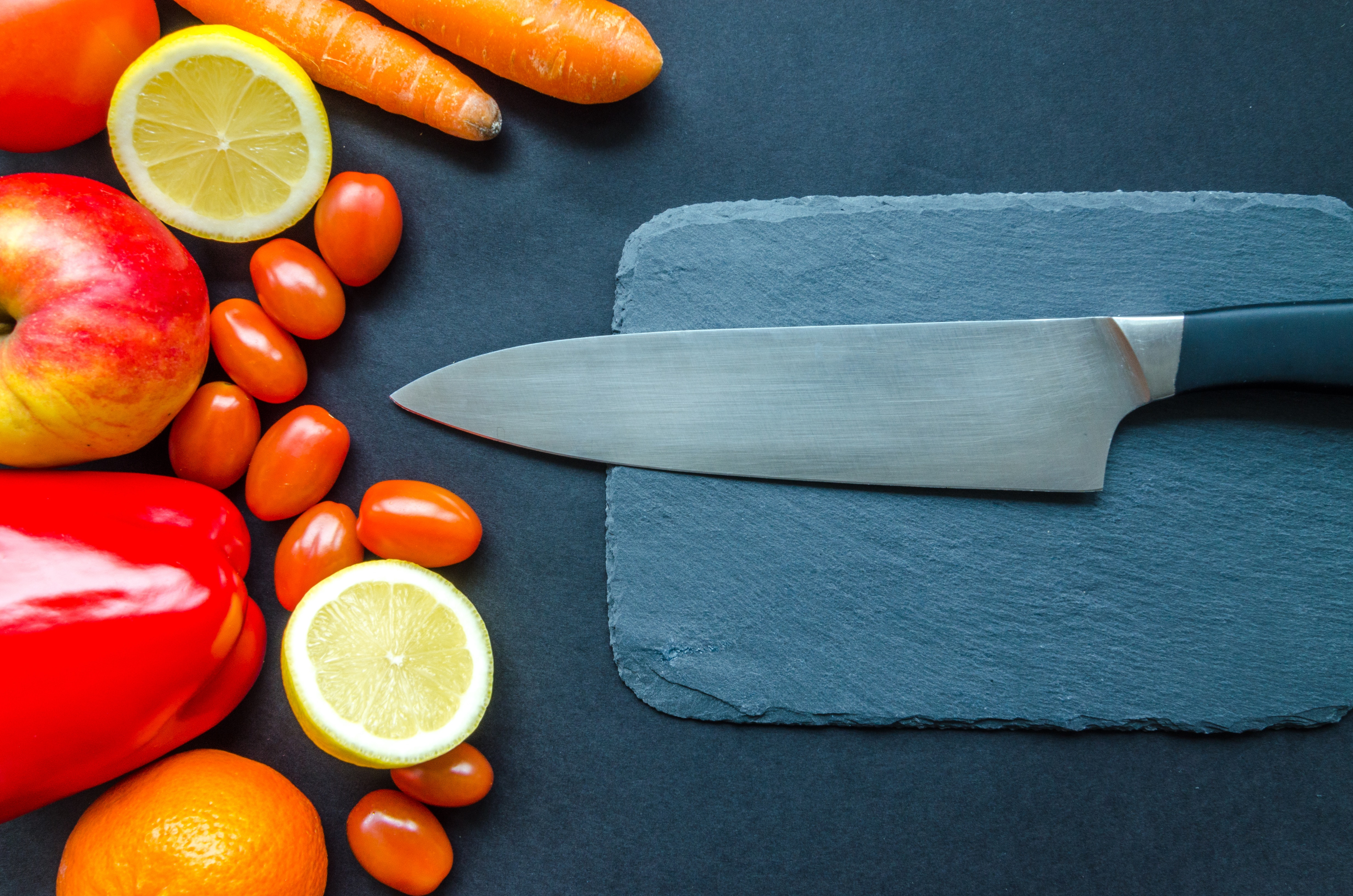 Black Kitchen Knife With Fruits and Vegetable on Table, Orange, Pepper, Lime, Lemon, HQ Photo