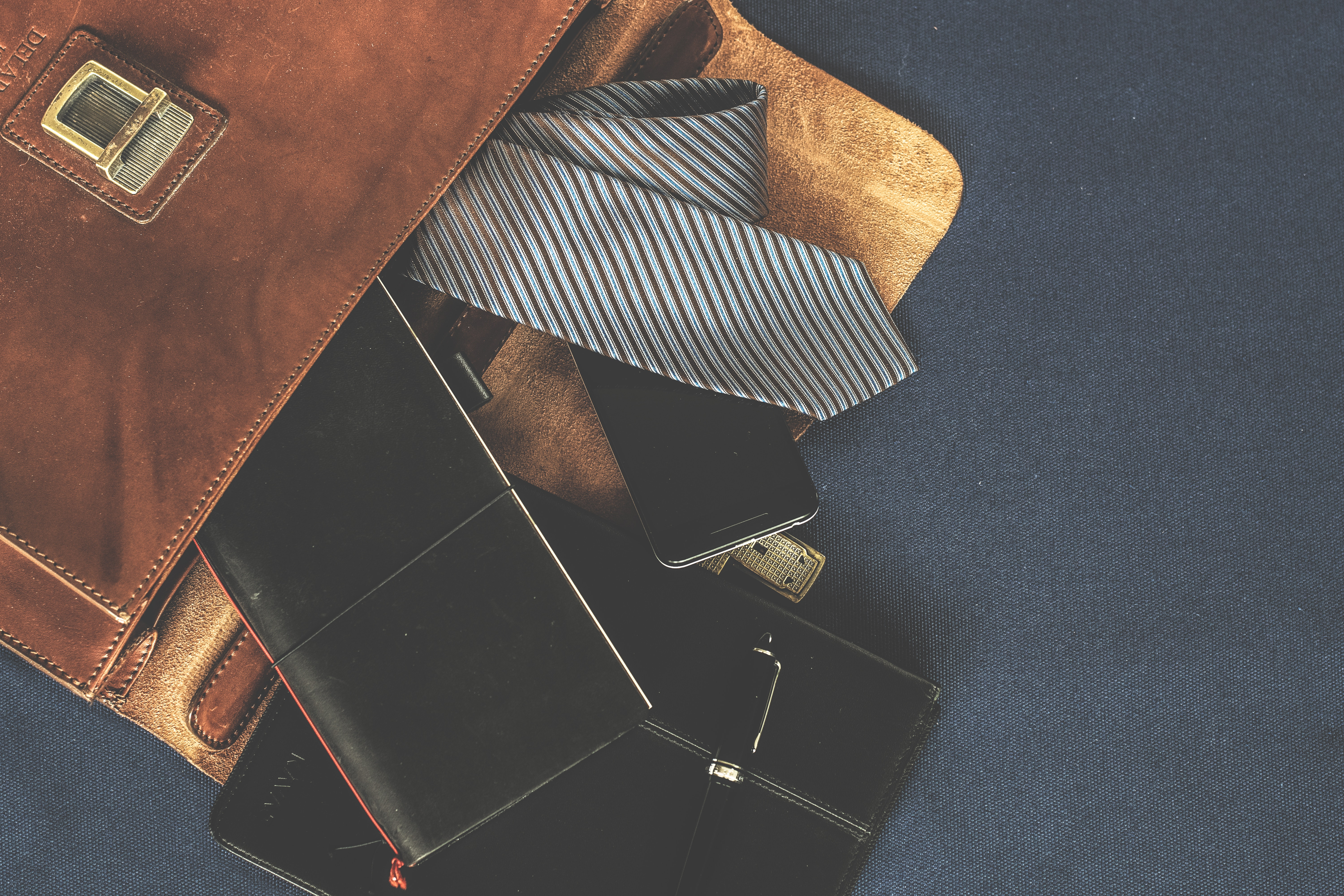 Black leather wallet near the necktie photo