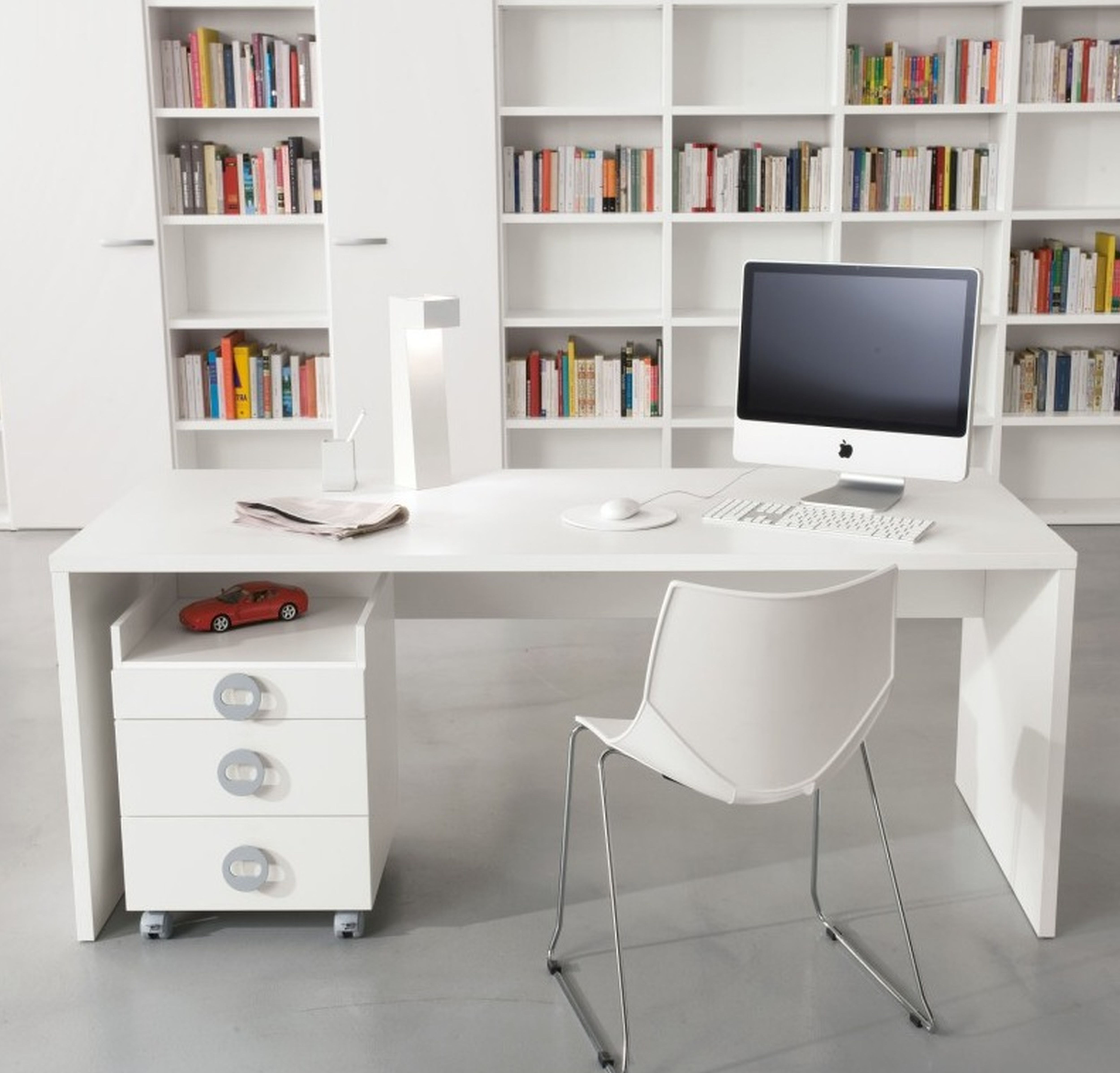 Black Mesh Office Rolling Chair Beside White Wooden Desk With Imac