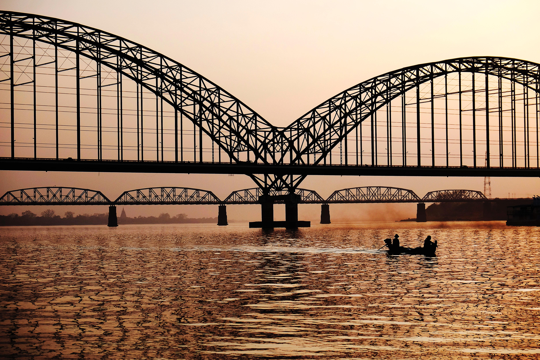 Black metal bridge near on body of water photo