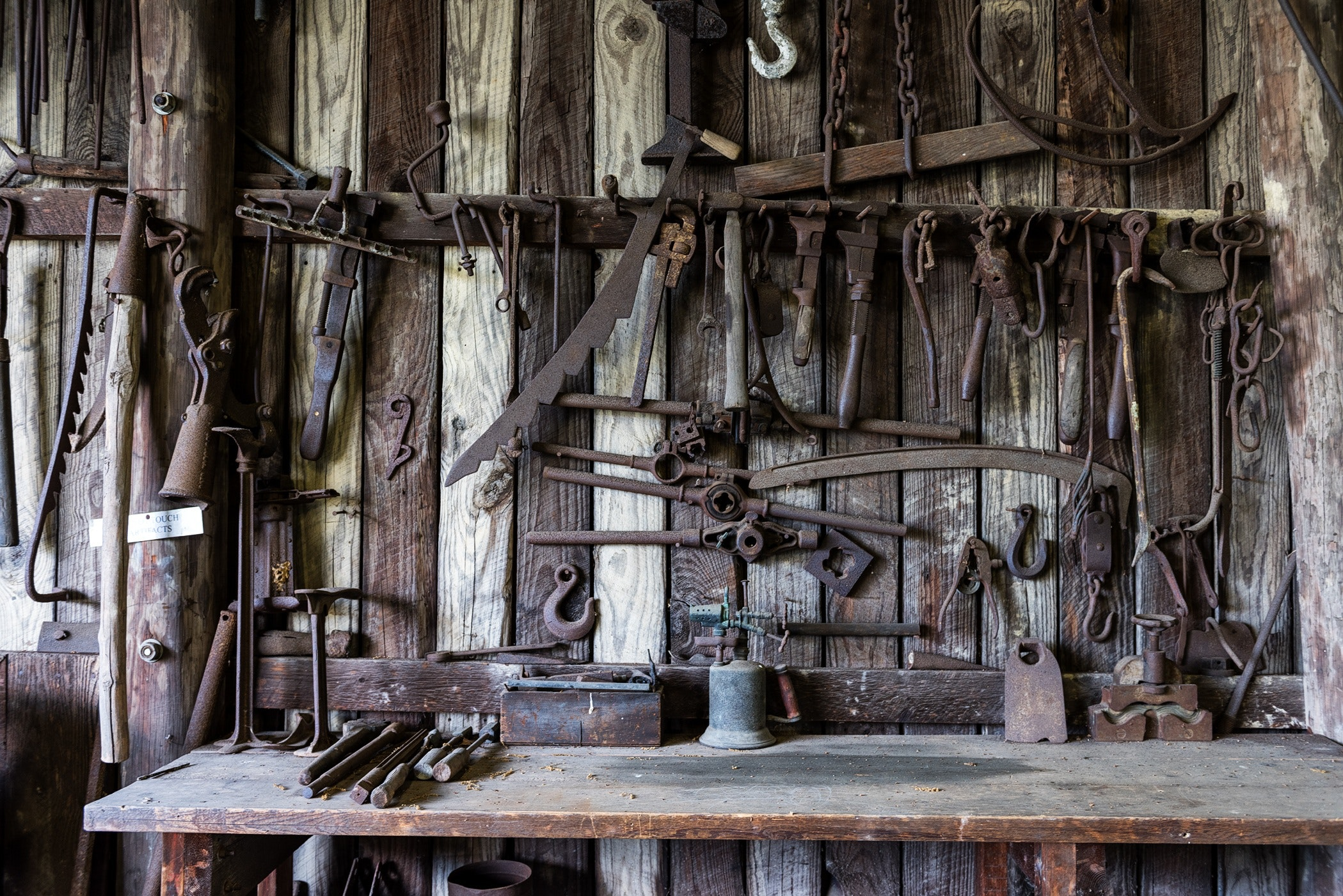 Black Metal Tools Hanged on a Rack Near Table, Craft, Monochrome, Old, Rust, HQ Photo