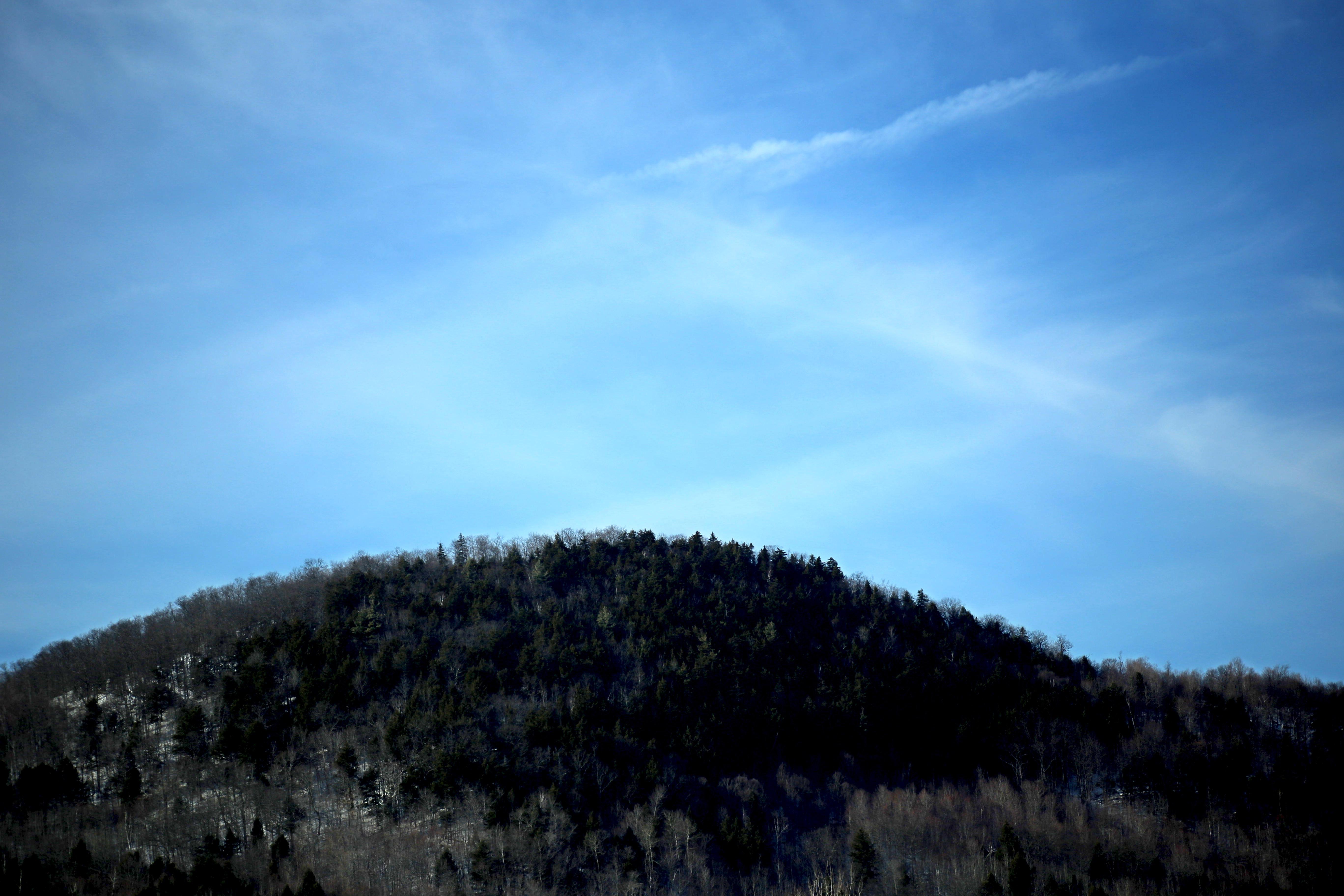 Black mountain during daytime photo