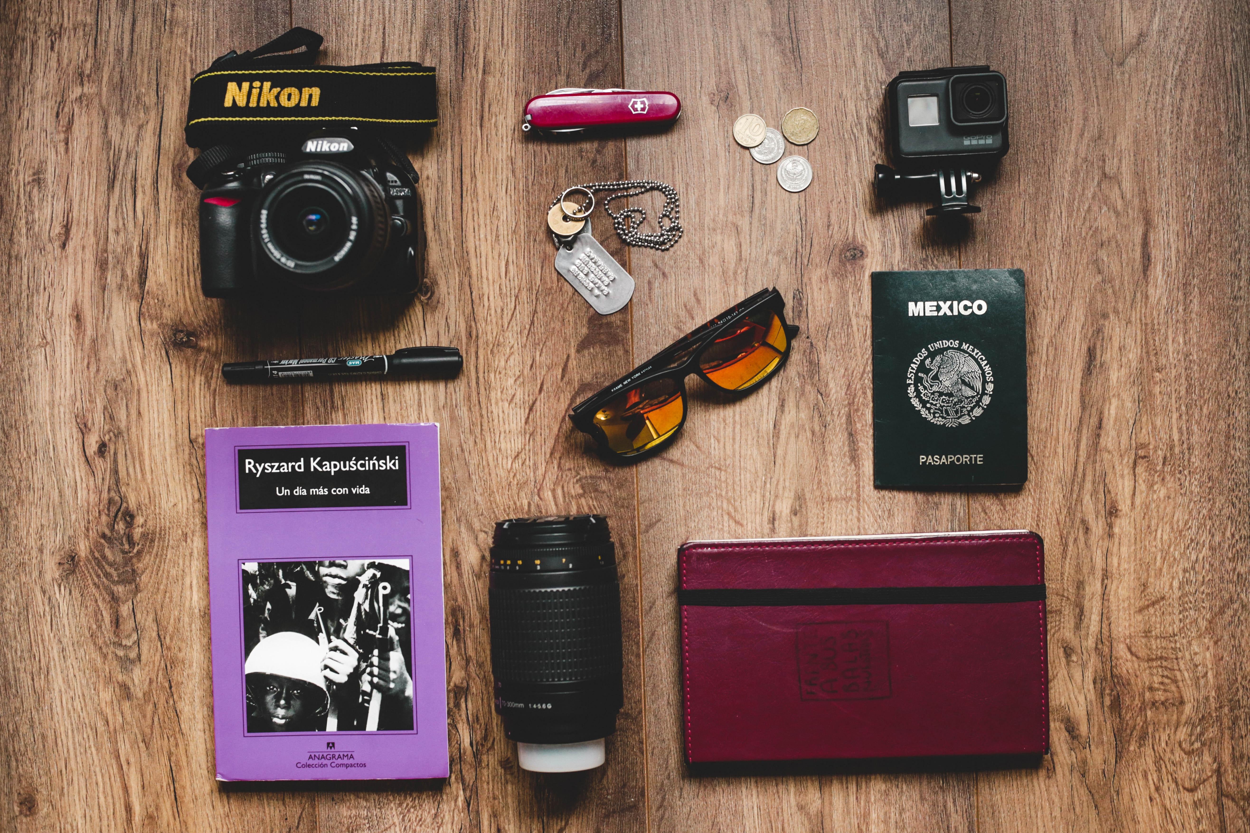 Black Nikon Dslr Camera, Gopro Hero Session, and Black Framed Sunglasses, Book, Paper, Technology, Table, HQ Photo