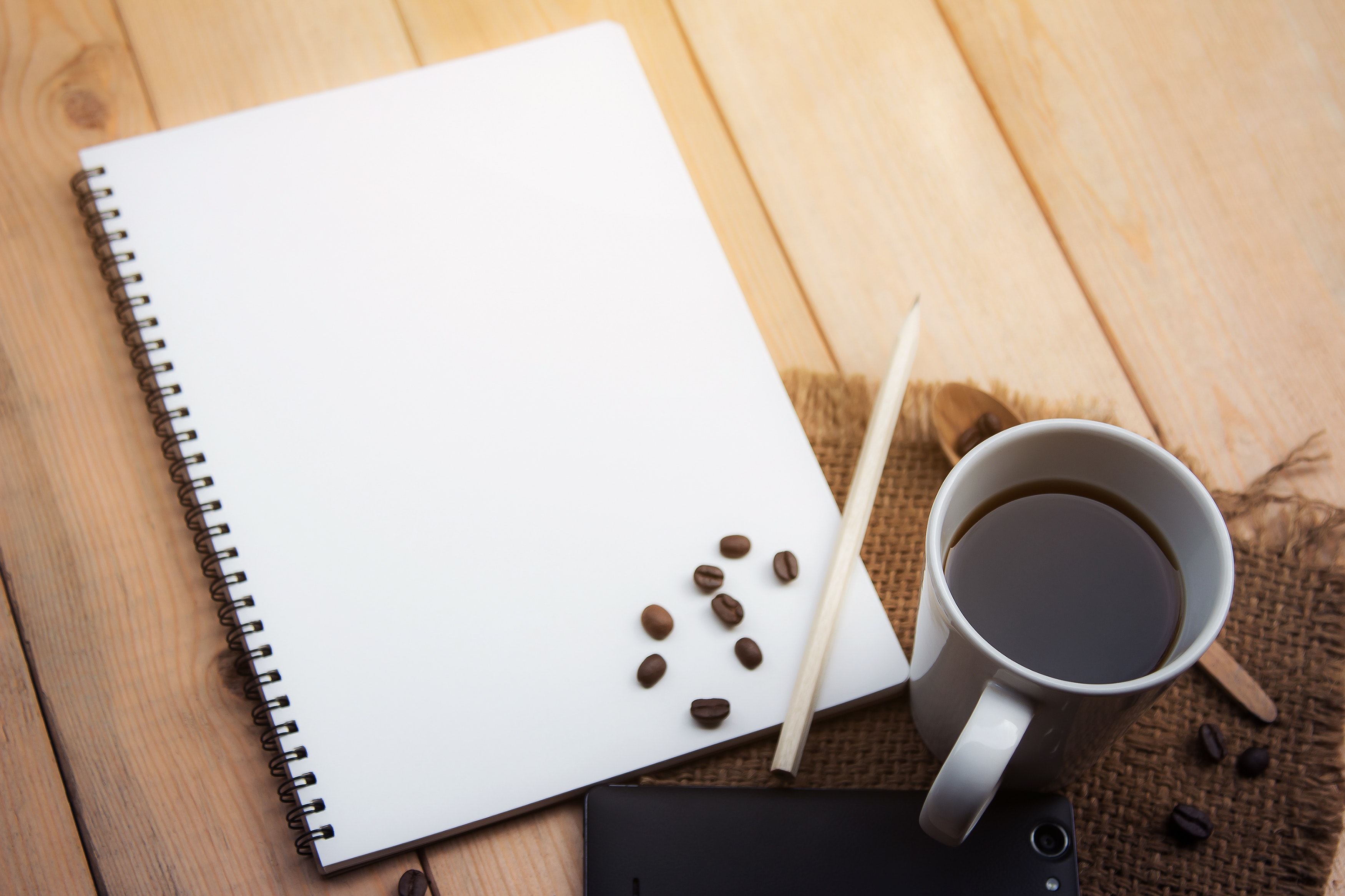 Blank paper with pen and coffee cup on wood table · Free Stock Photo