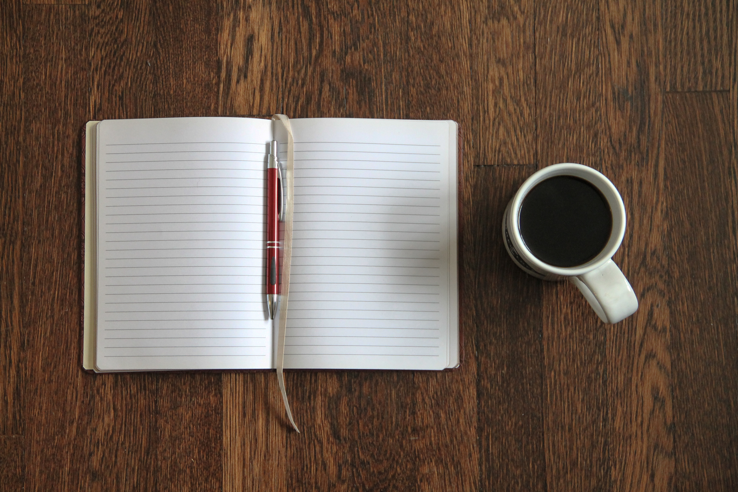 Free Stock Photo of Blank Open Notebook & Coffee on Desk