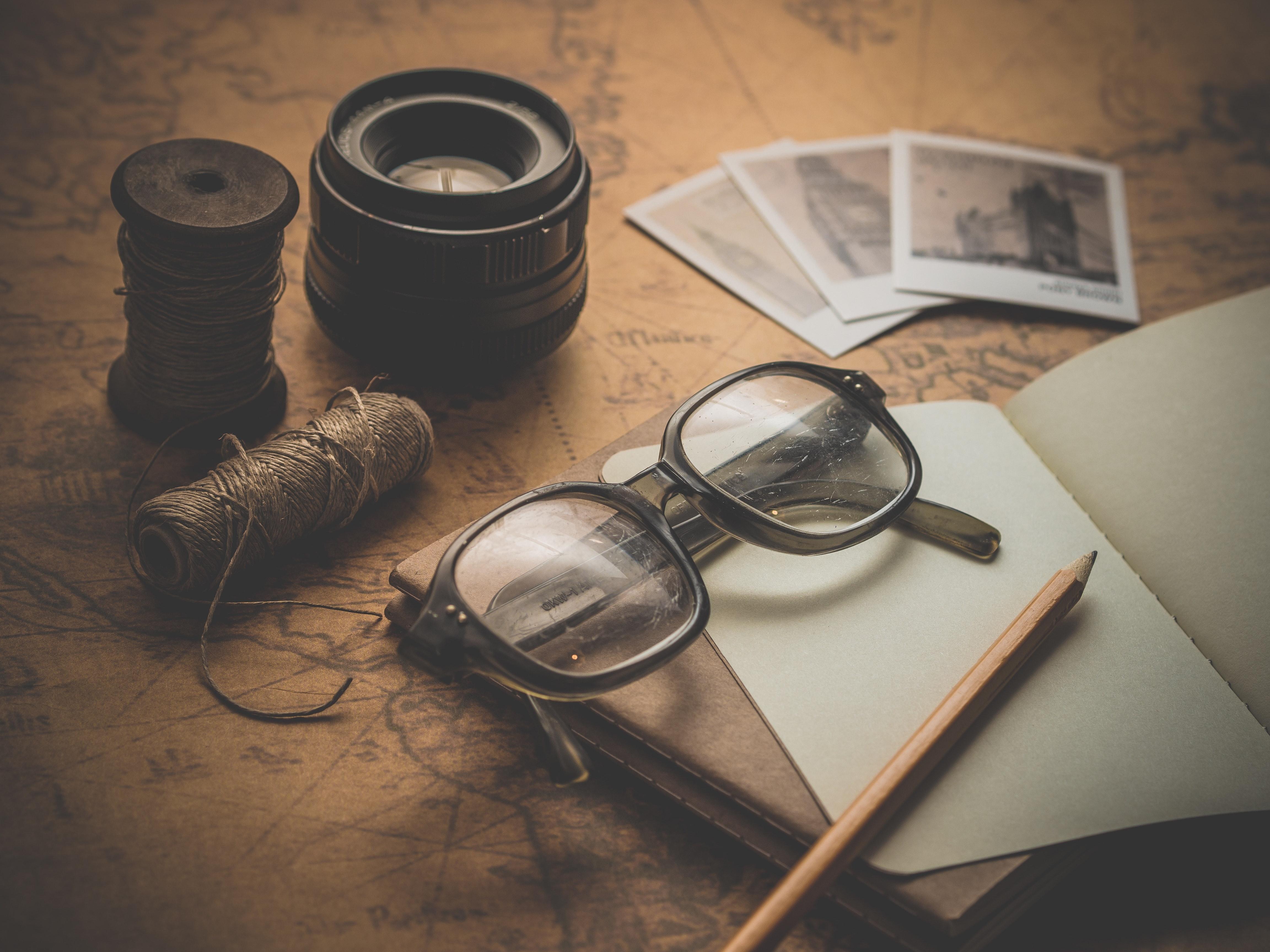 071c3bd8d9 Free photo  Black Framed Eyeglasses Near Graphing Paper Spiral ...