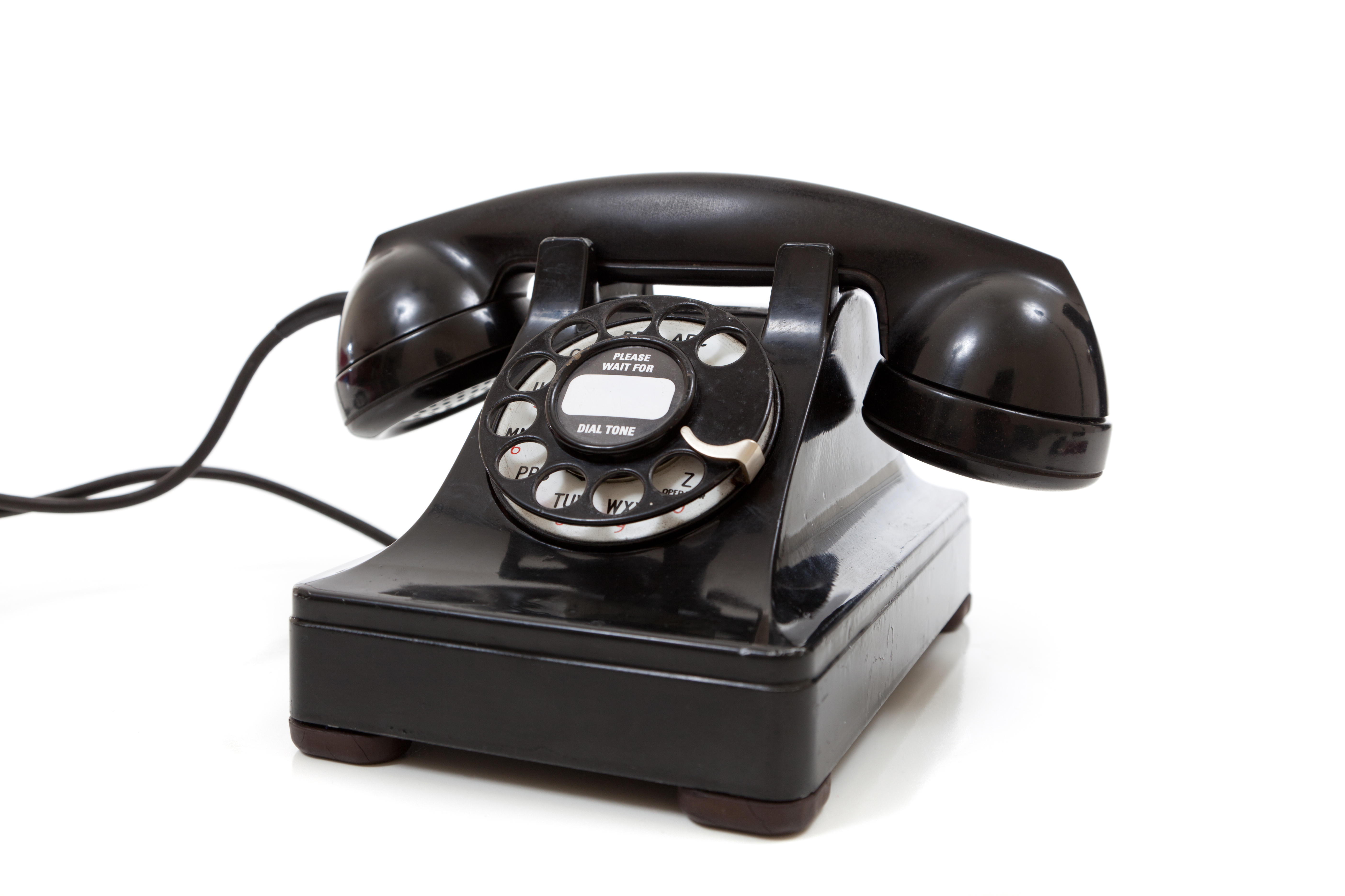 A black vintage rotary phone on a white background -