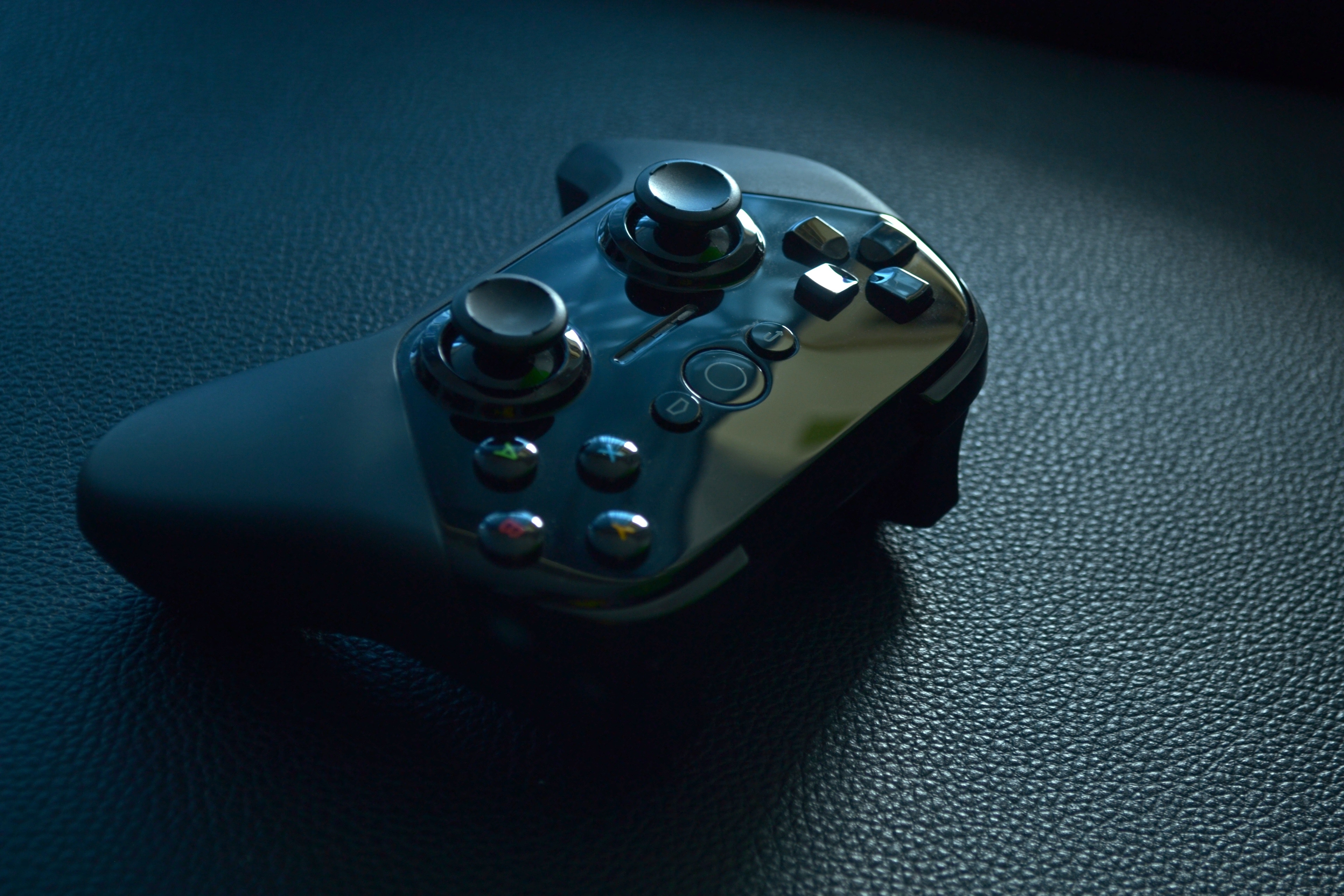 Black Wireless Game Controller on Black Leather, Analogue, Buttons, Close-up, Control, HQ Photo