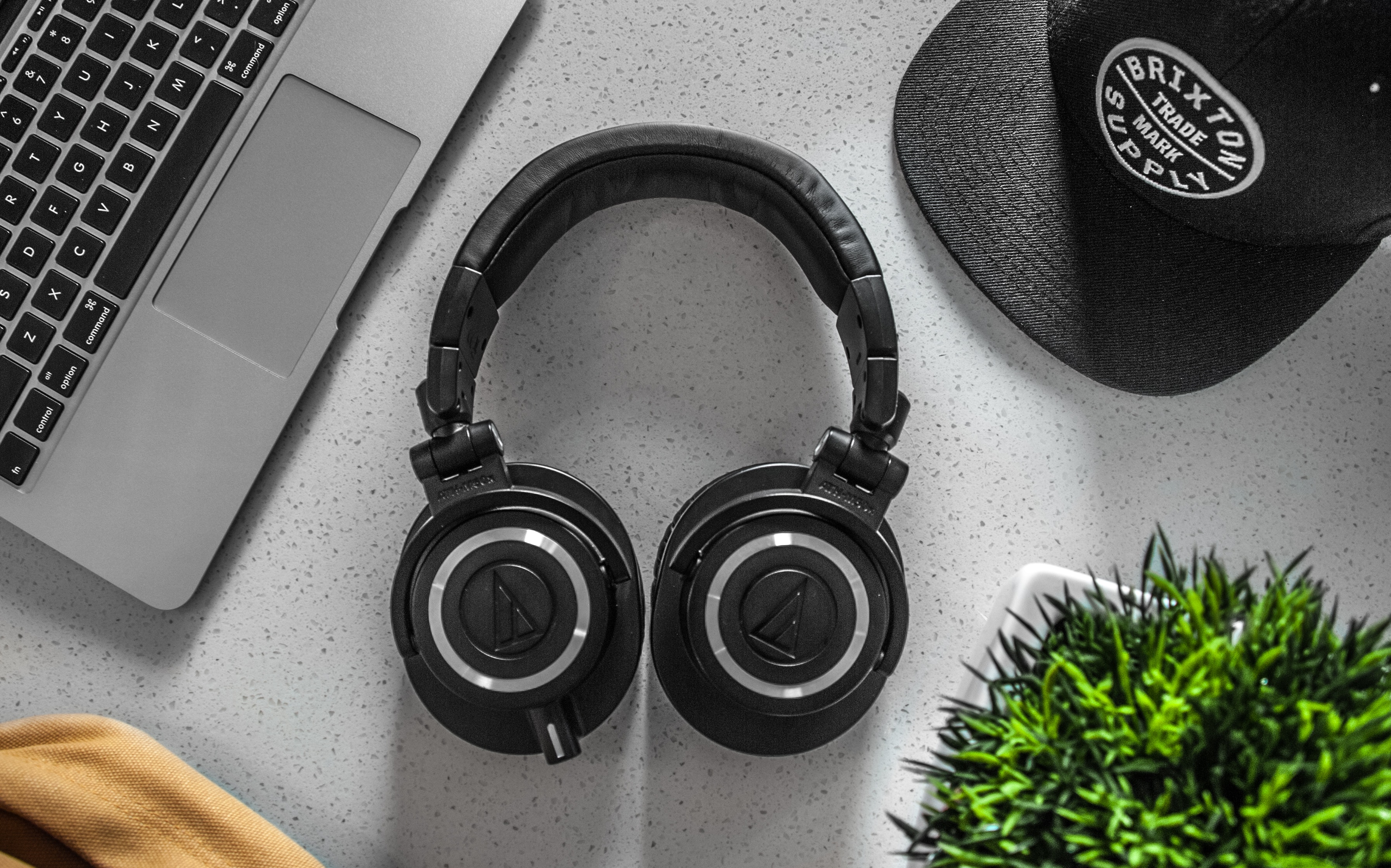 Black wireless headphones on white table photo