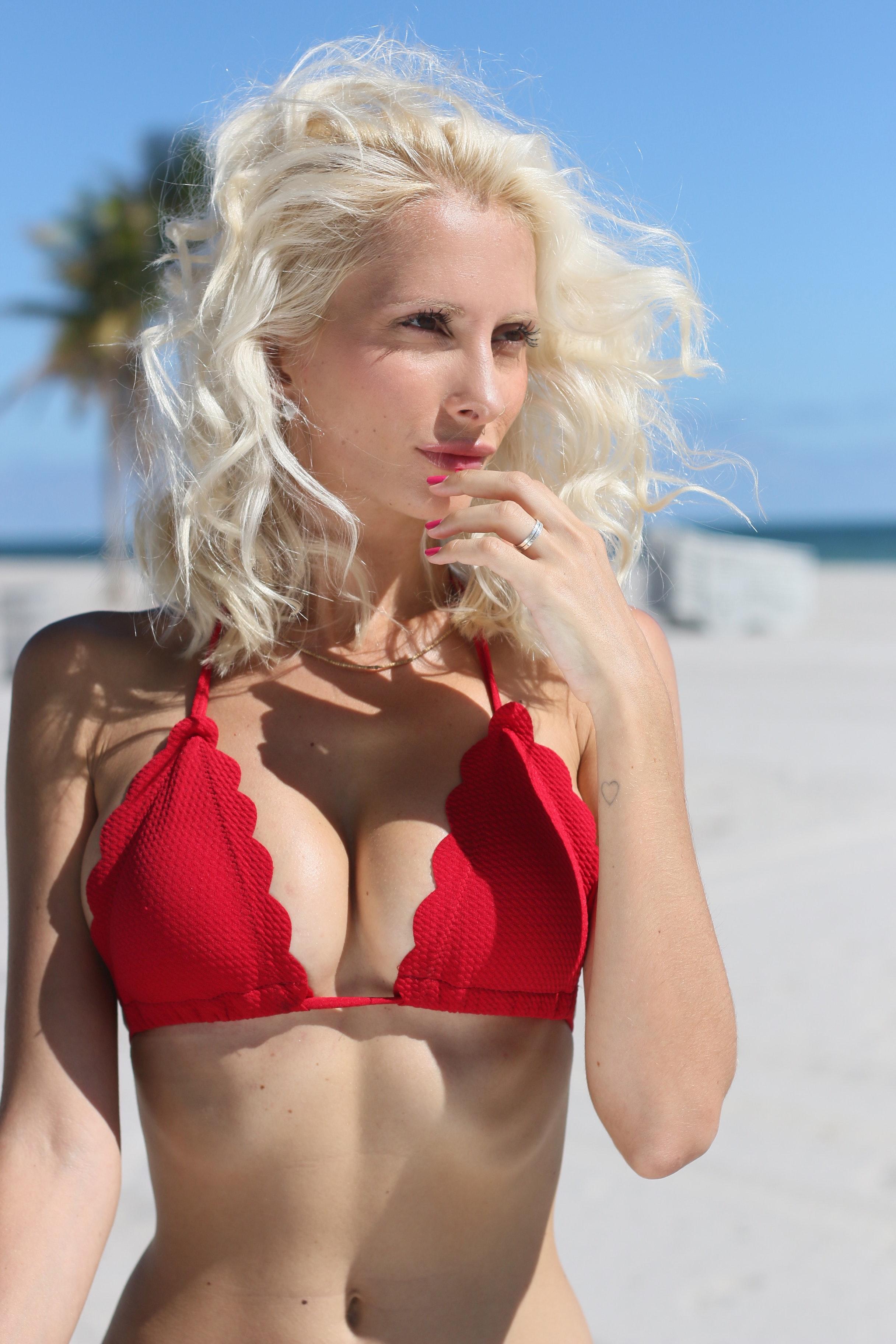 Blonde hair woman wearing red bikini photo