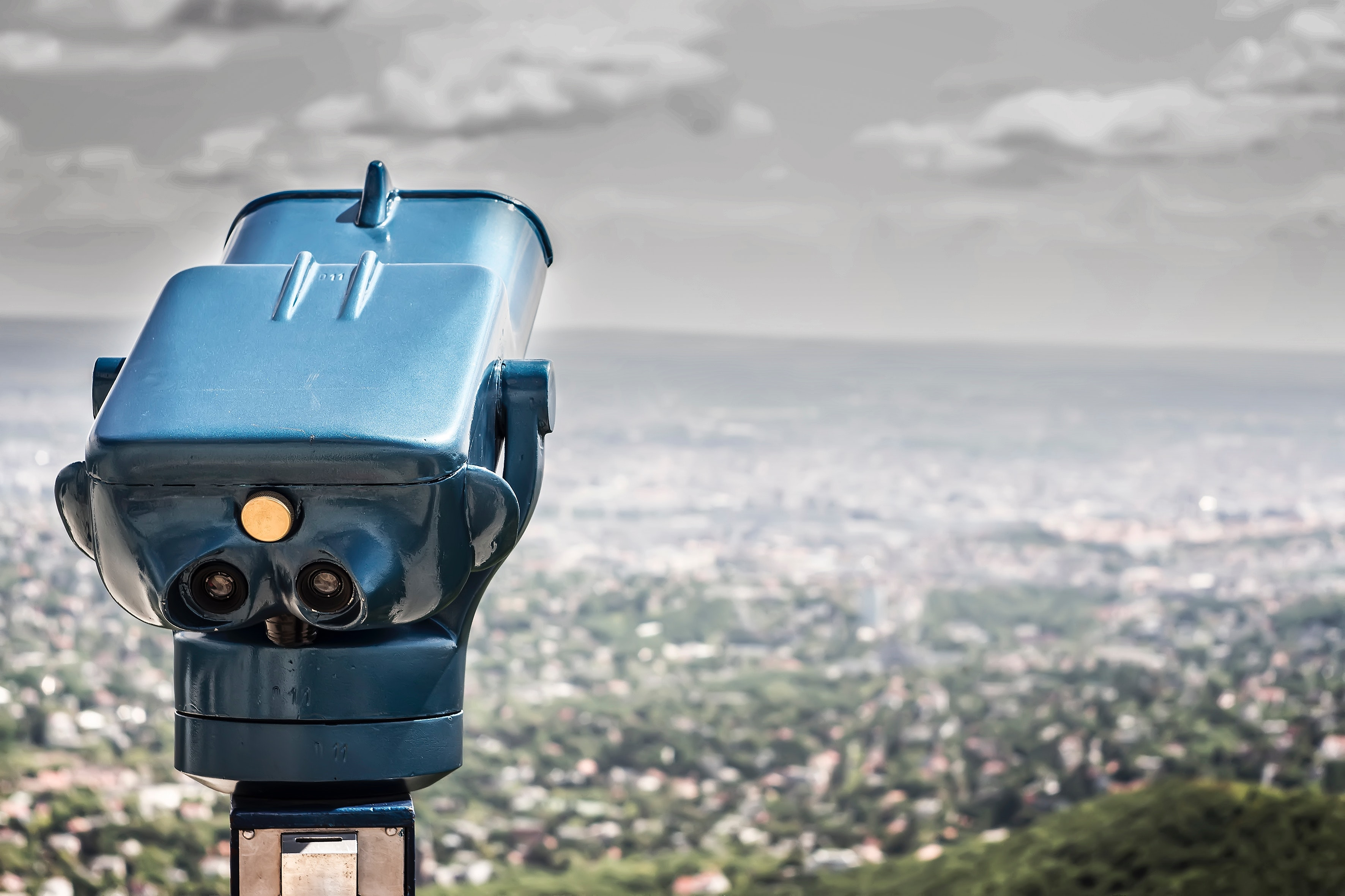 Blue coin operated binocular with city view during daytime photo