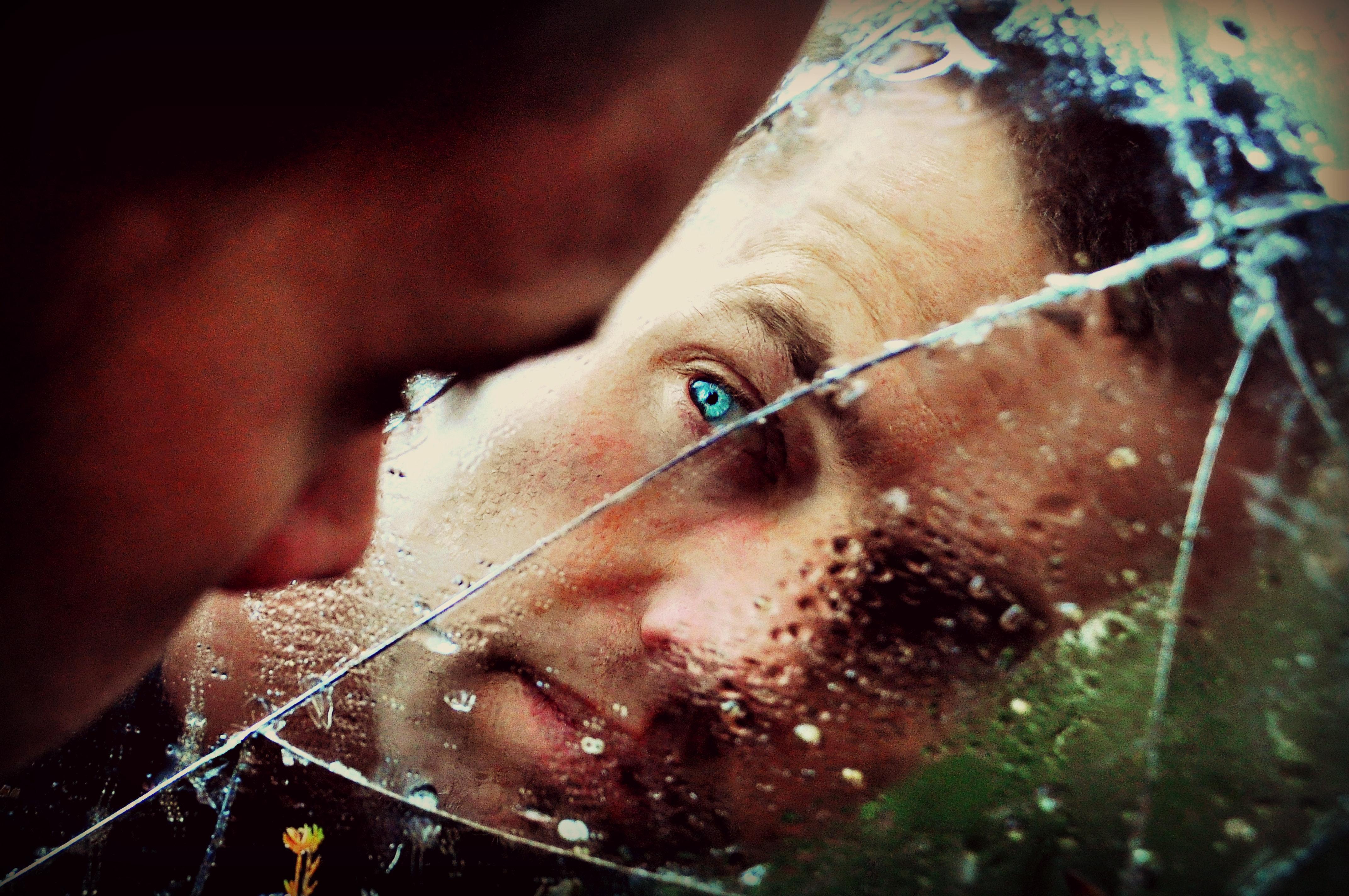 Blue eyed man staring at the mirror photo