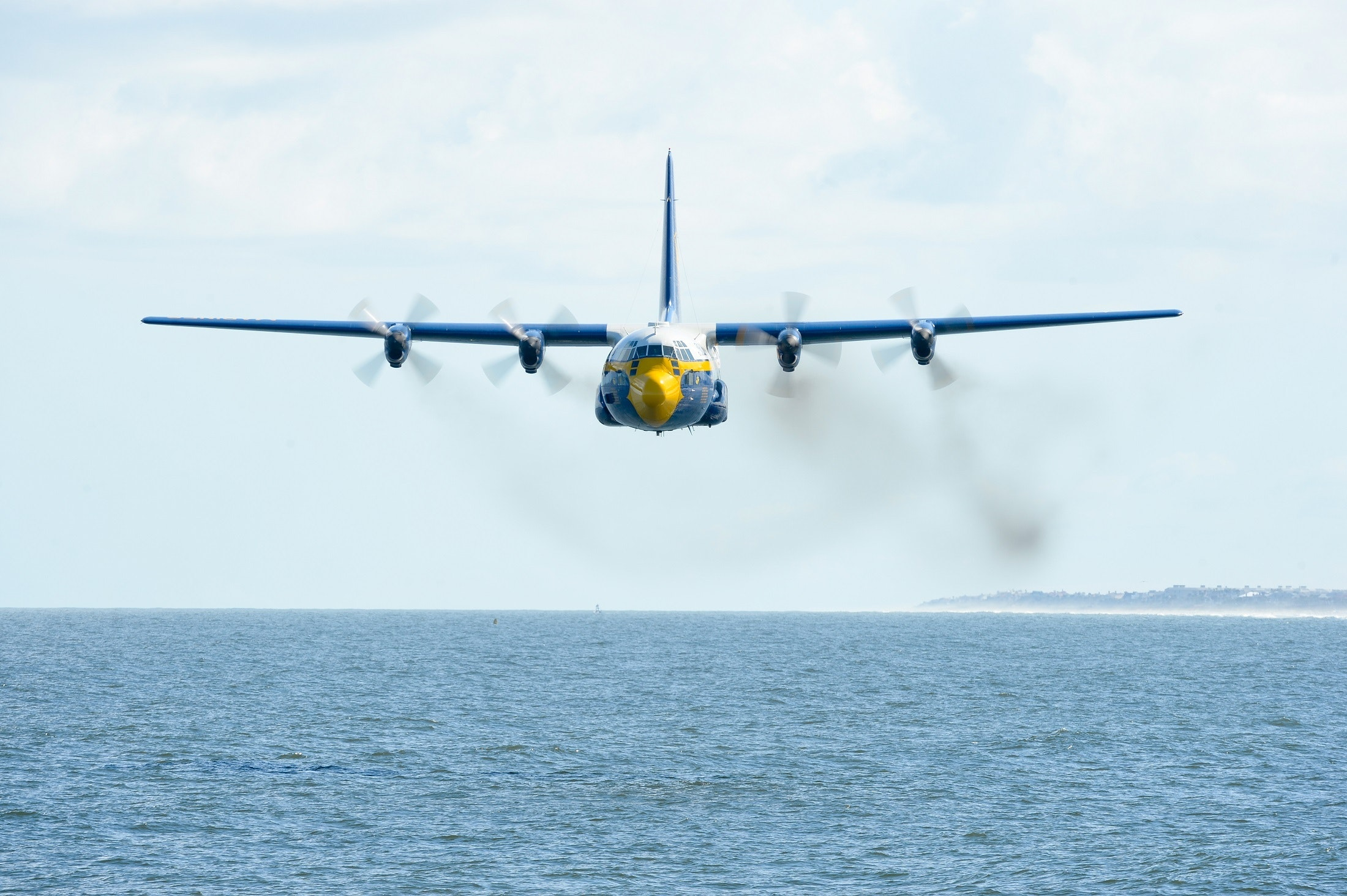 Blue flying airplane photo