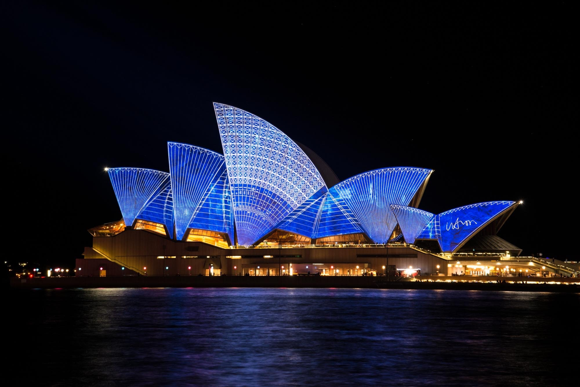 Blue lighted sydney opera house during nighttime photo