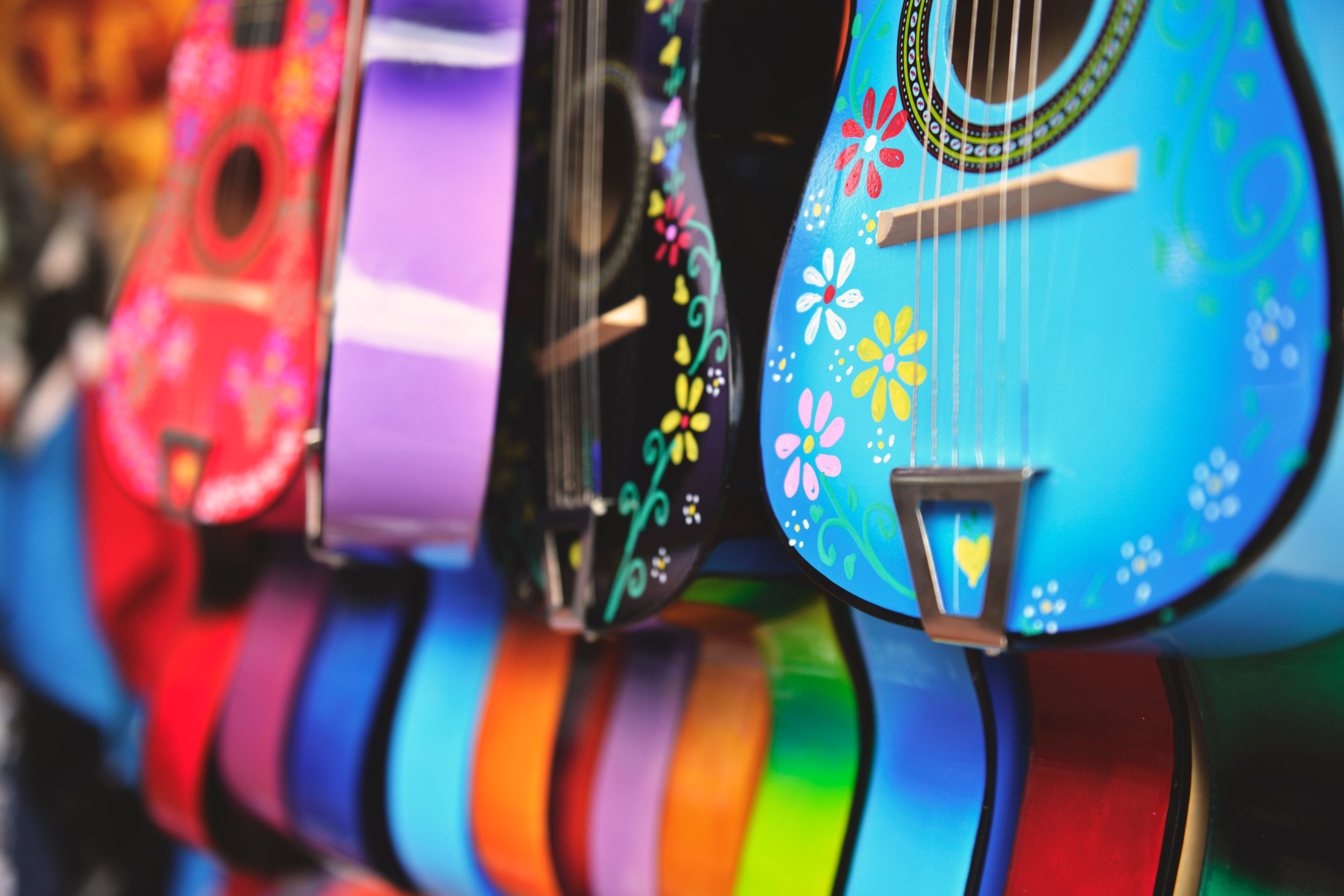 Blue, purple and green acoustic guitars photo