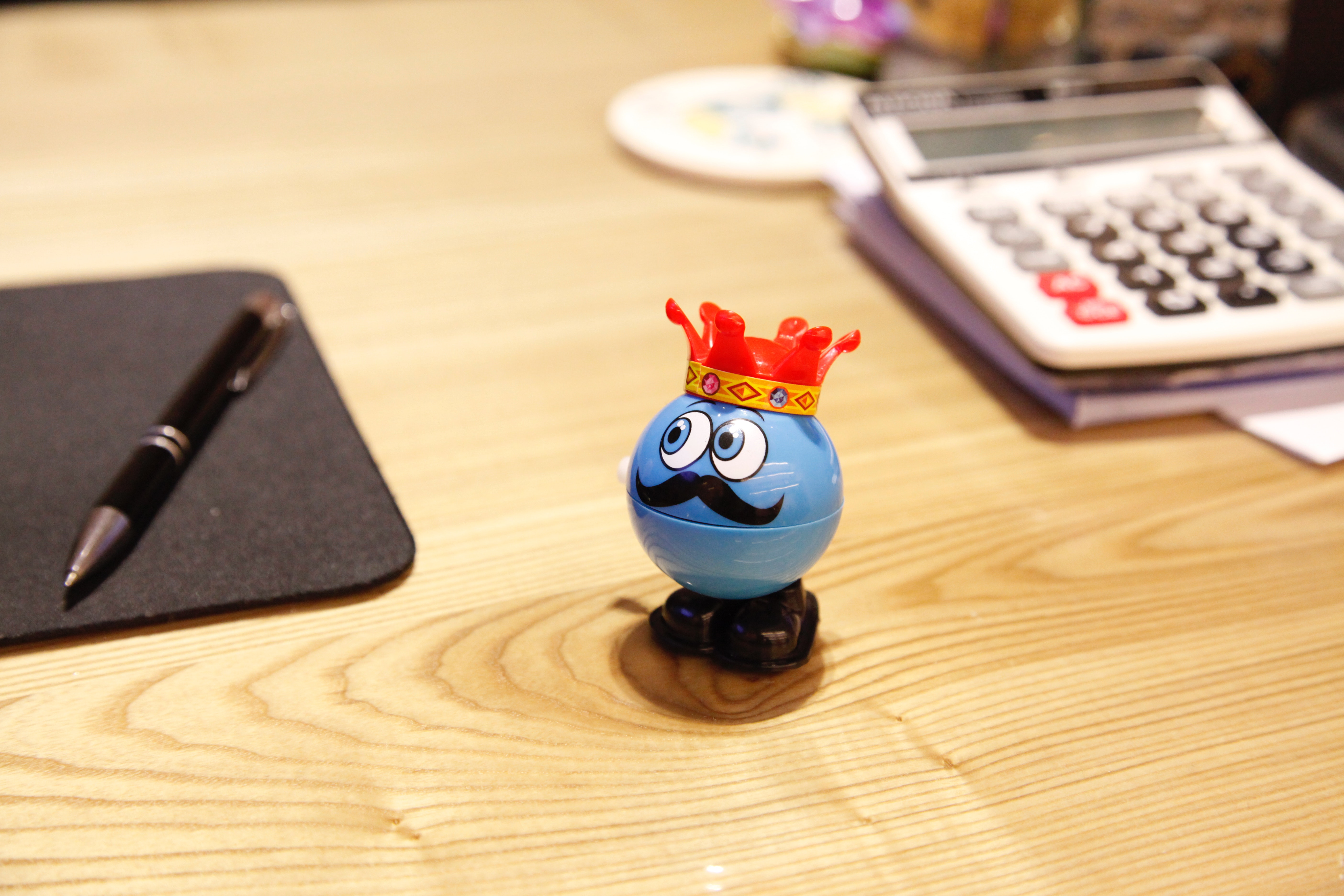 Blue round plastic toy on a desk photo