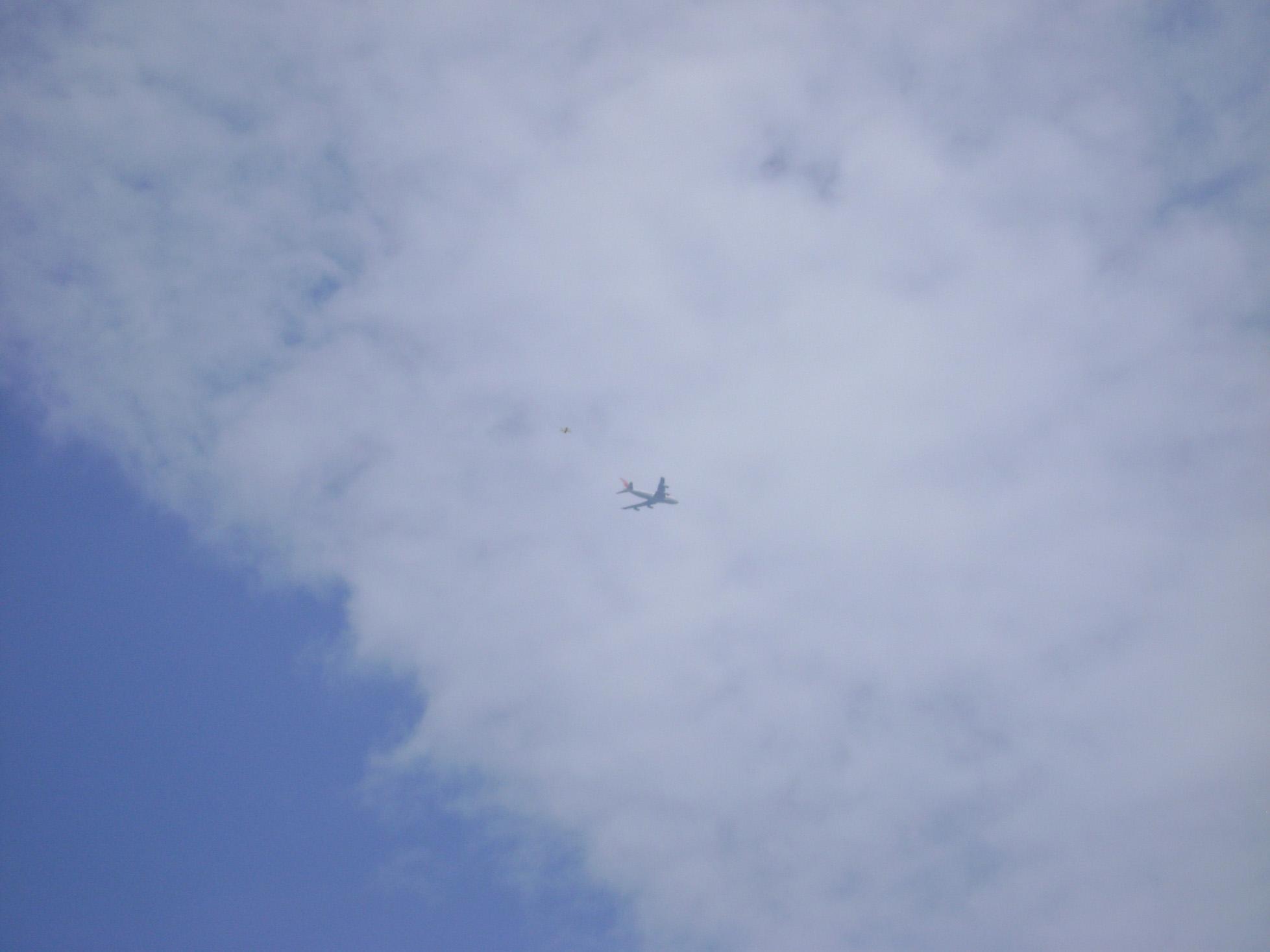 Blue sky with aeroplane photo