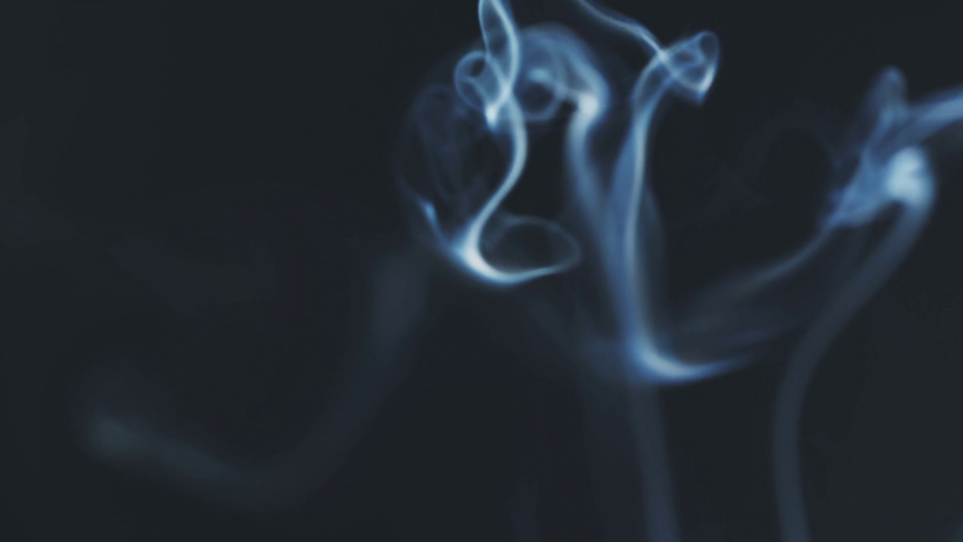 closeup video of blue smoke rising over black background in 180fps ...