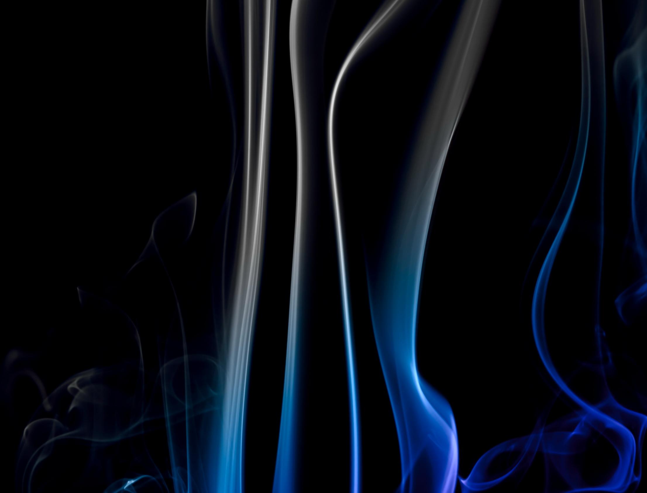Blue smoke on black photo