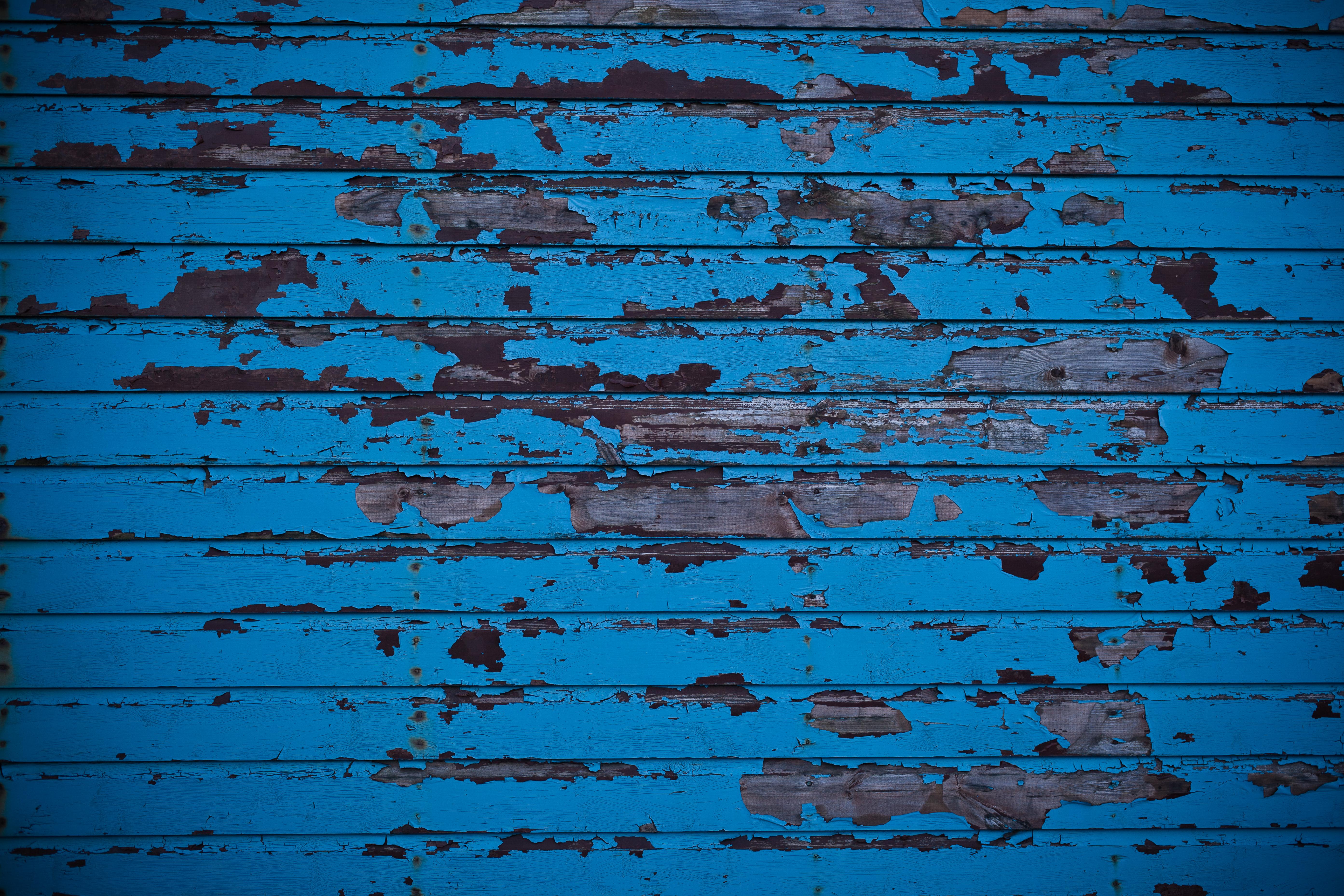 Free photo Blue Wall and Peeled Paint Texture Peeling Peeled