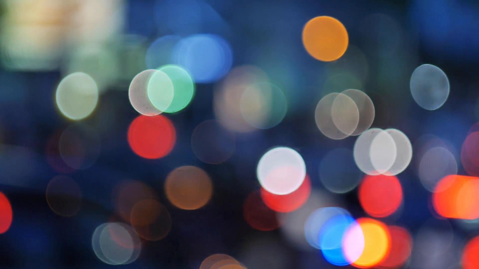Pan across city blur background. Moving bokeh circles of night ...