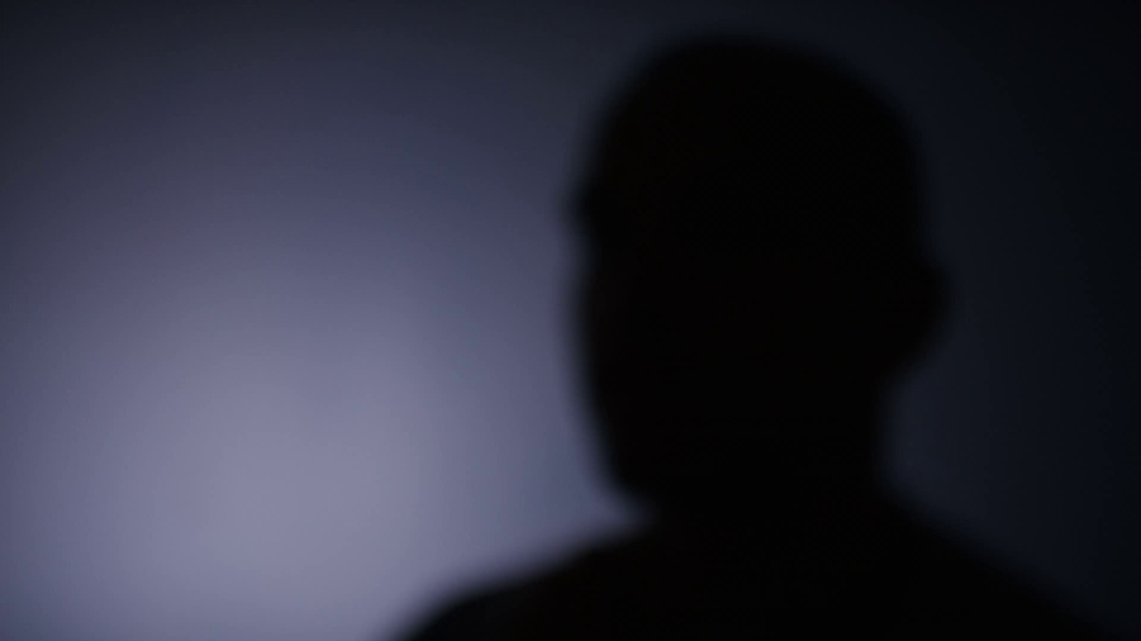 4K Blurred silhouette of anonymous person talking to keep identity ...