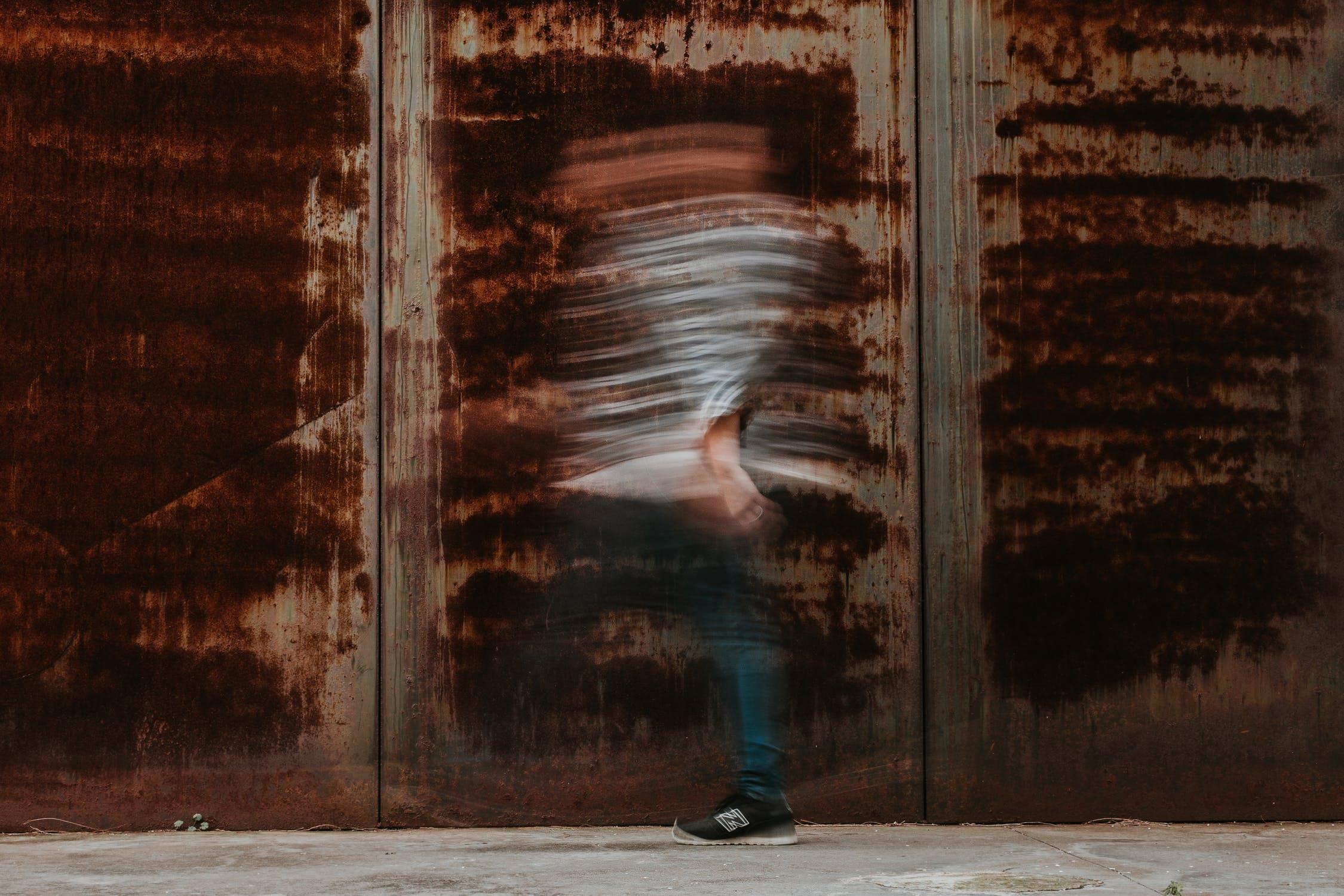 blurred person, blurred person