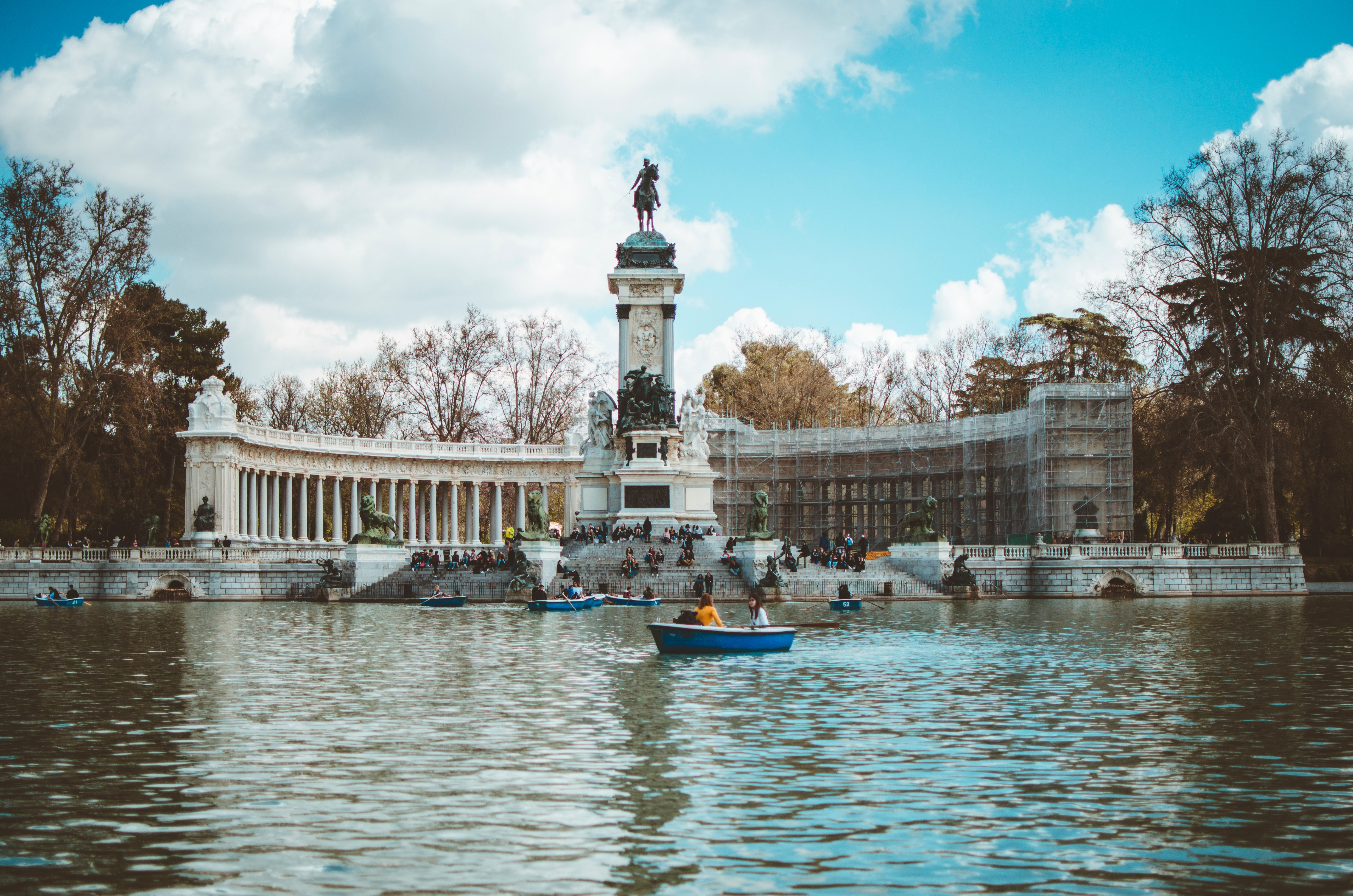 Boat in water and building with statue photo