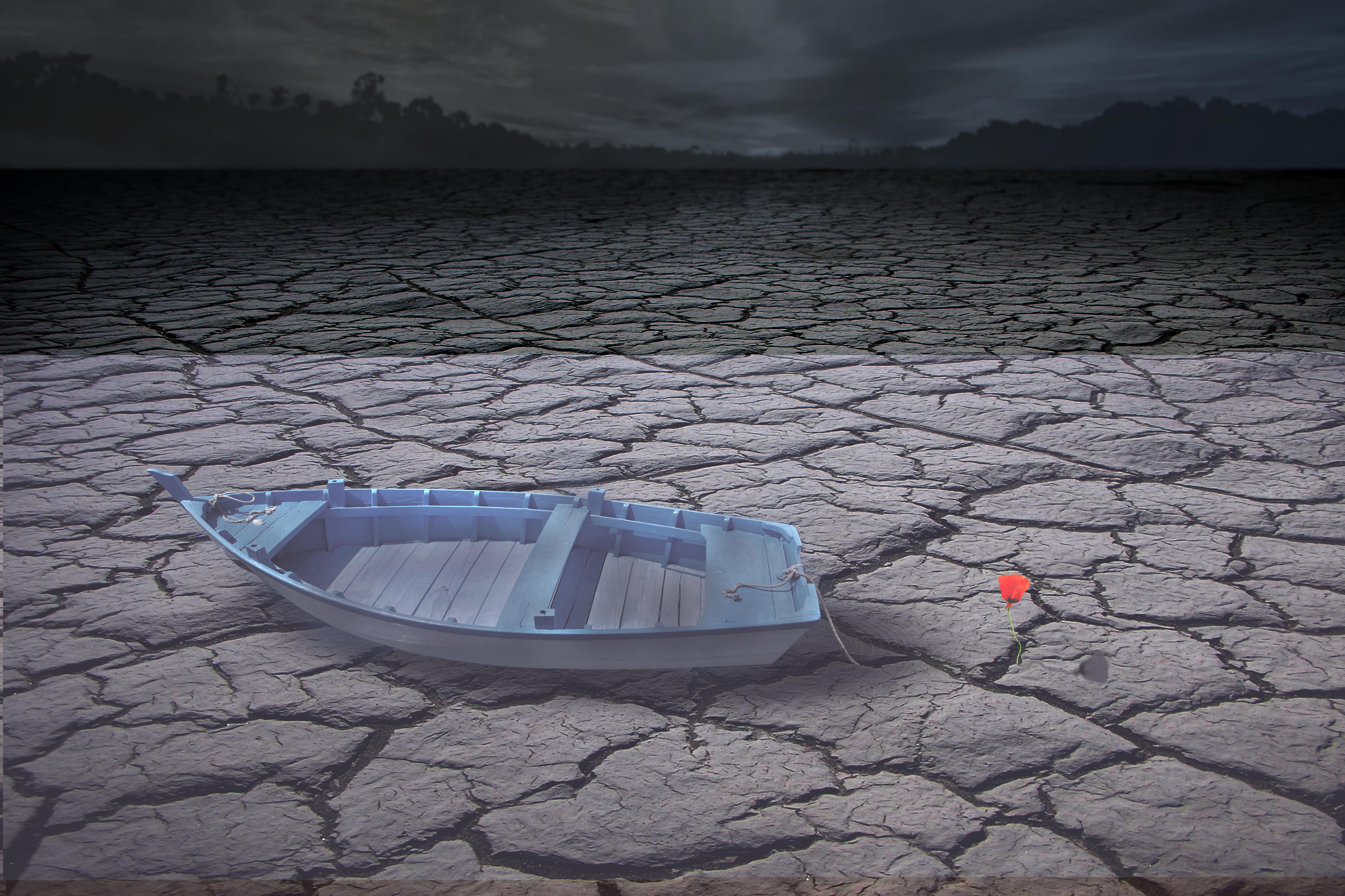 Boat on barren land photo