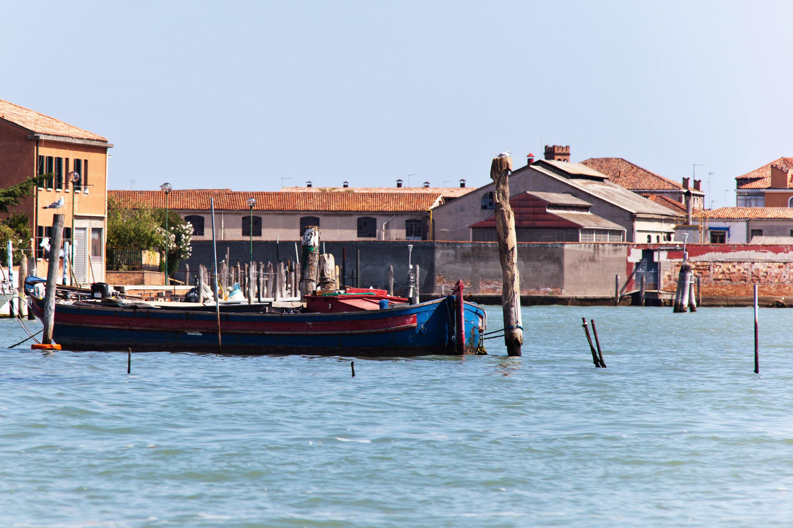 Boats moored in venice, italy photo