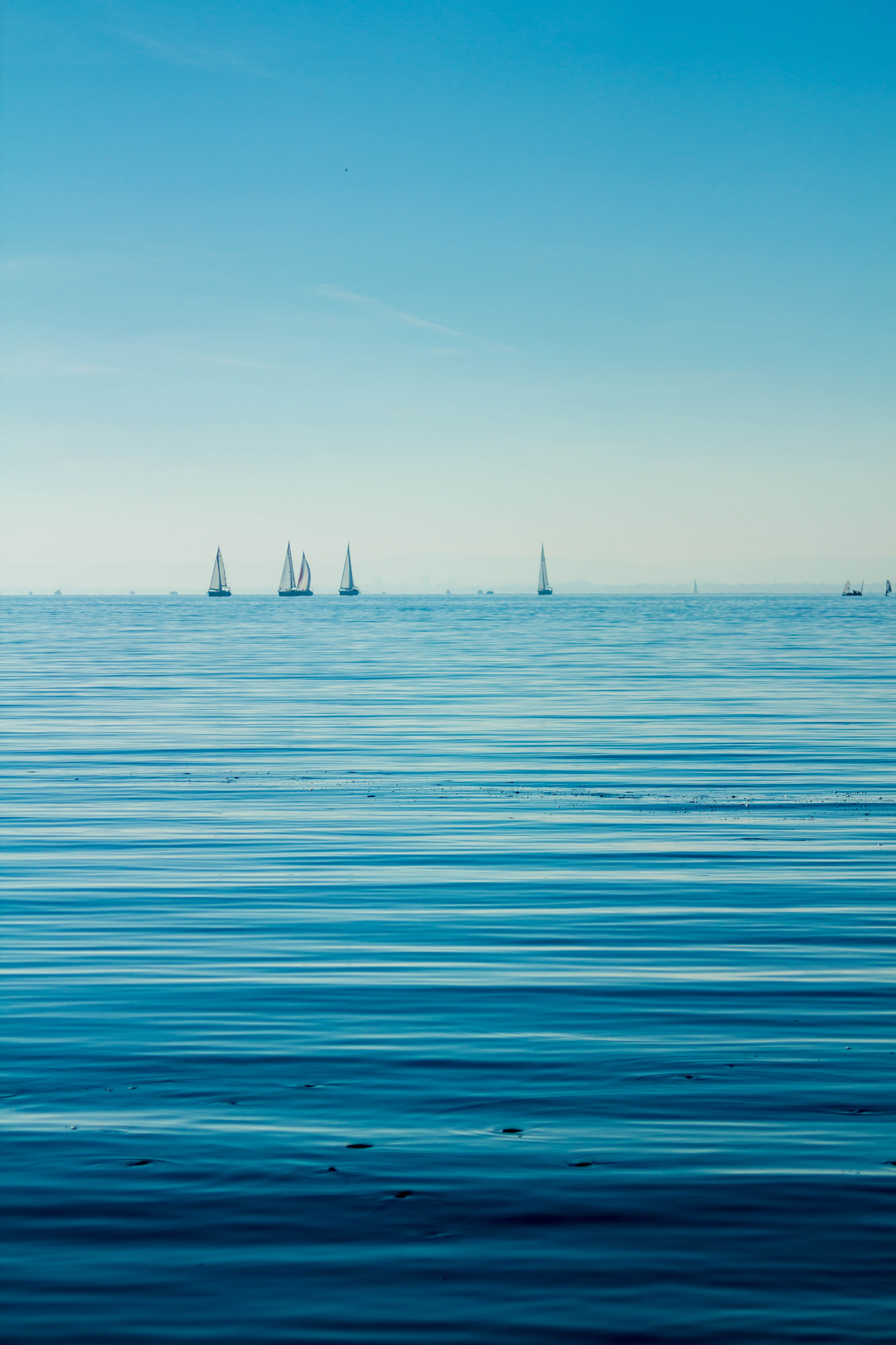 Boats on body of water under blue sky photo