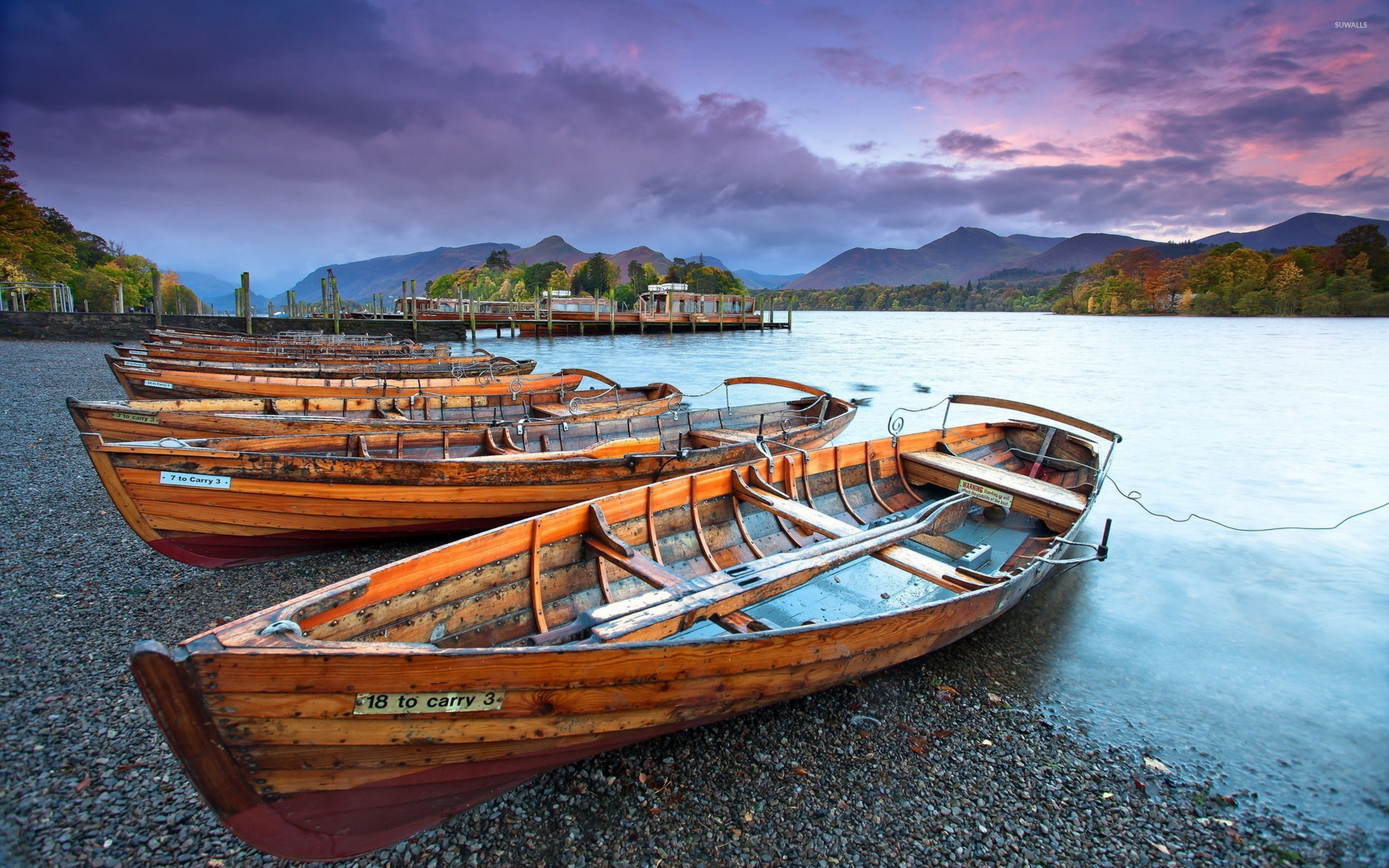 Wooden boats on the pebble beach of the river wallpaper ...