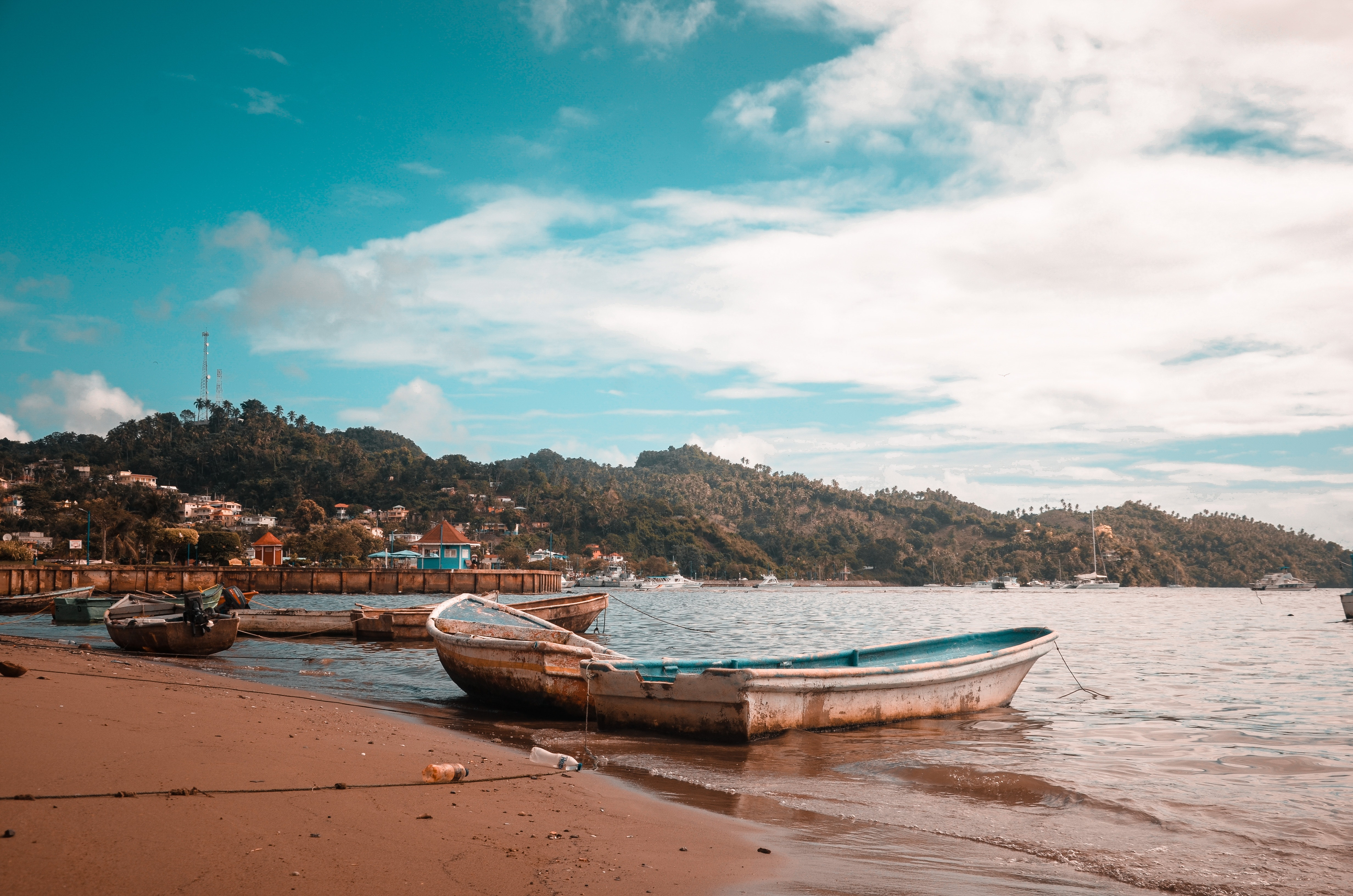 Boats on seashore during daytime photo