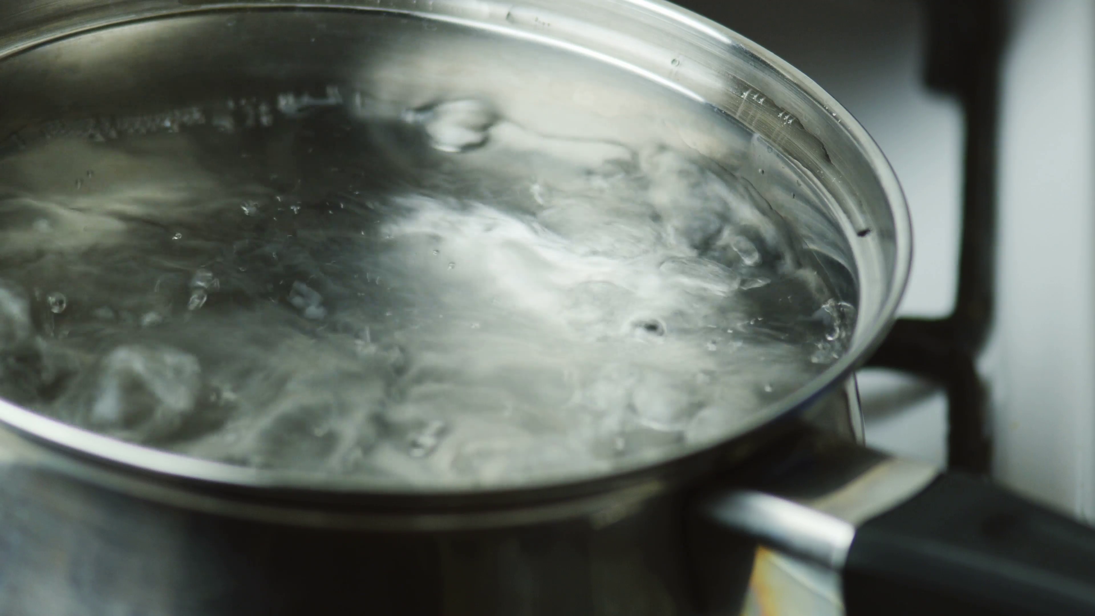 Boiling Water in a Pot Bubbling Over Stock Video Footage - Videoblocks
