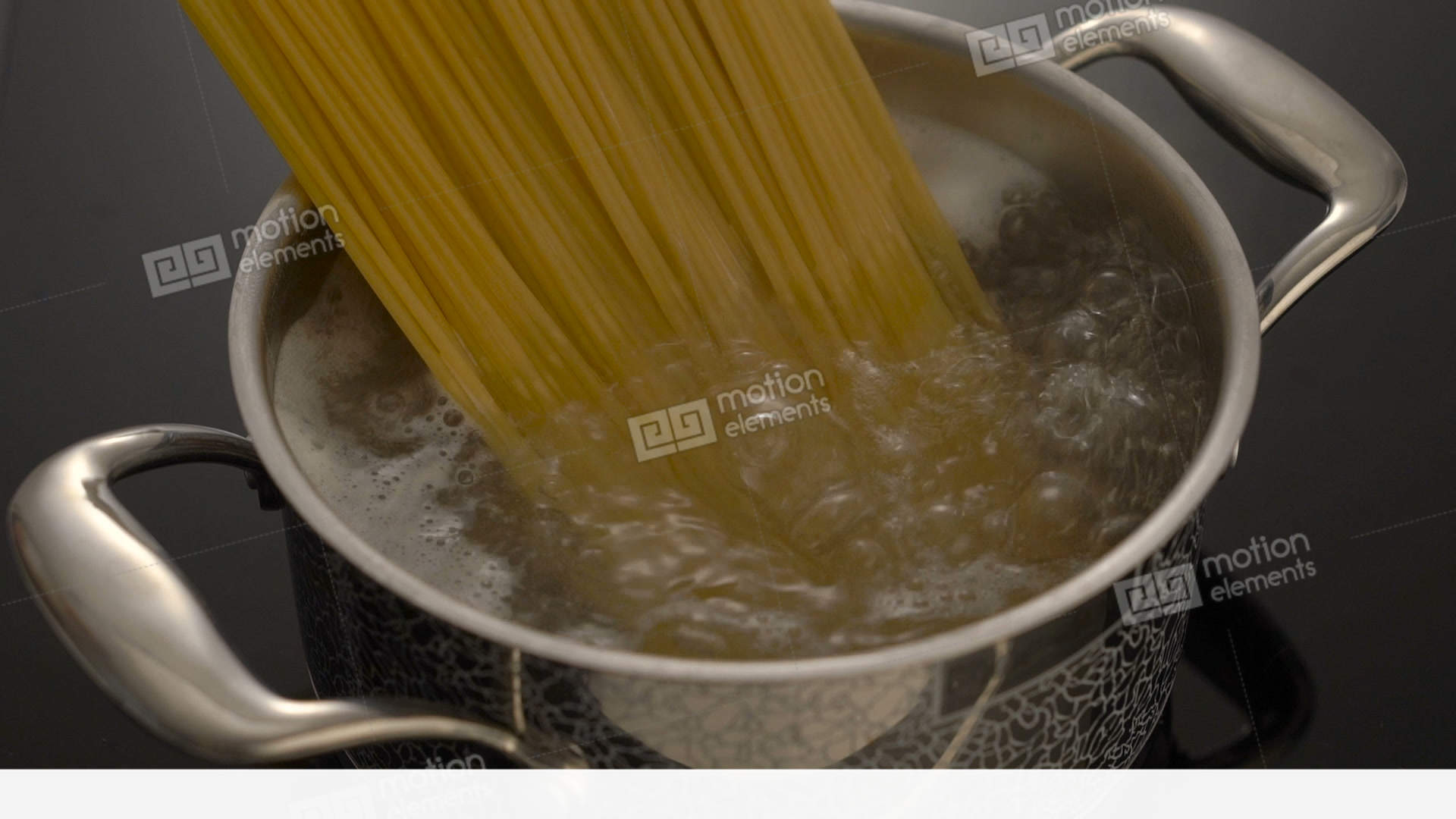 Cooking Spaghetti In Boiling Water In Pot On Electric Stove Stock ...