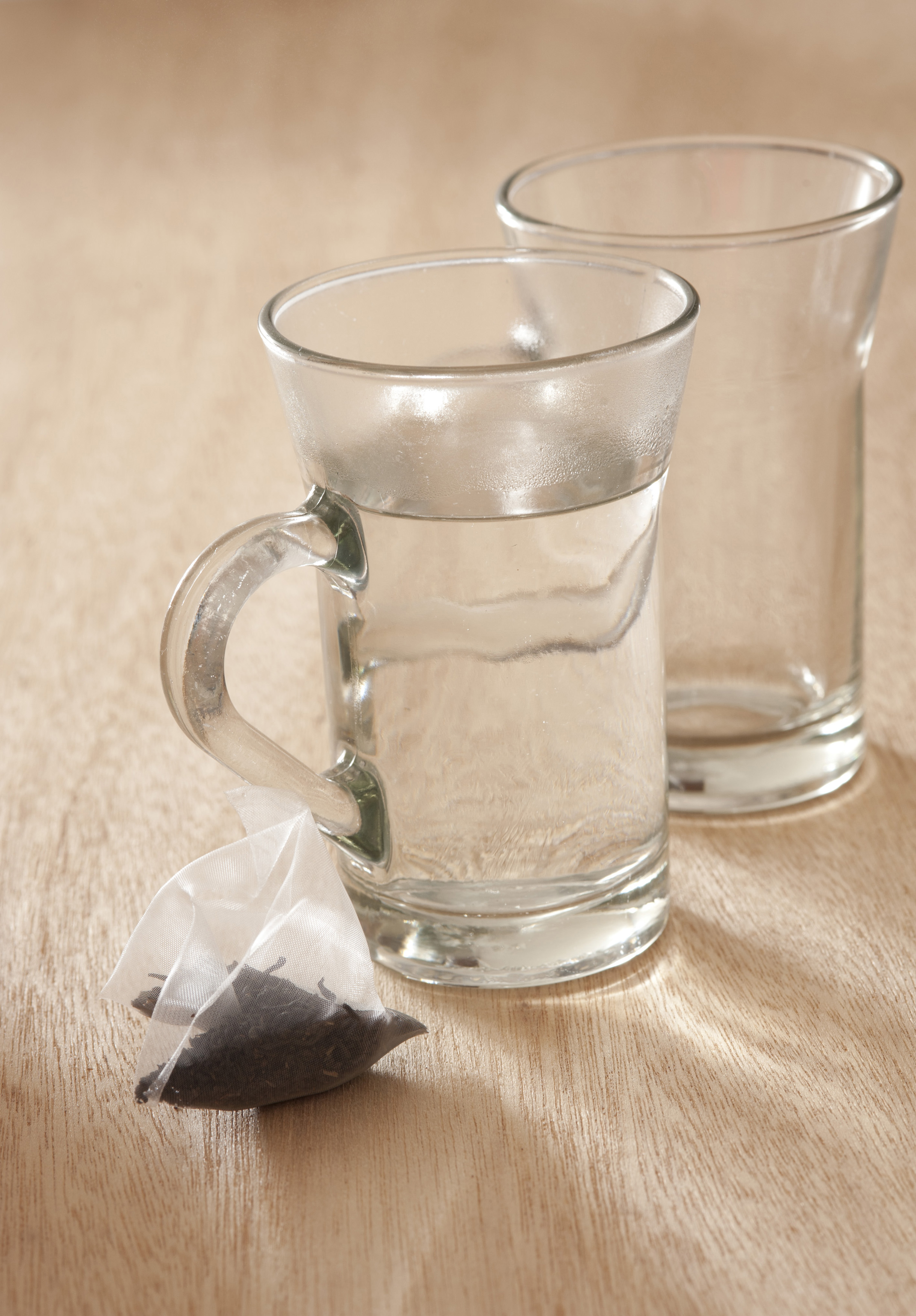 Glass mug filled with boiling water - Free Stock Image