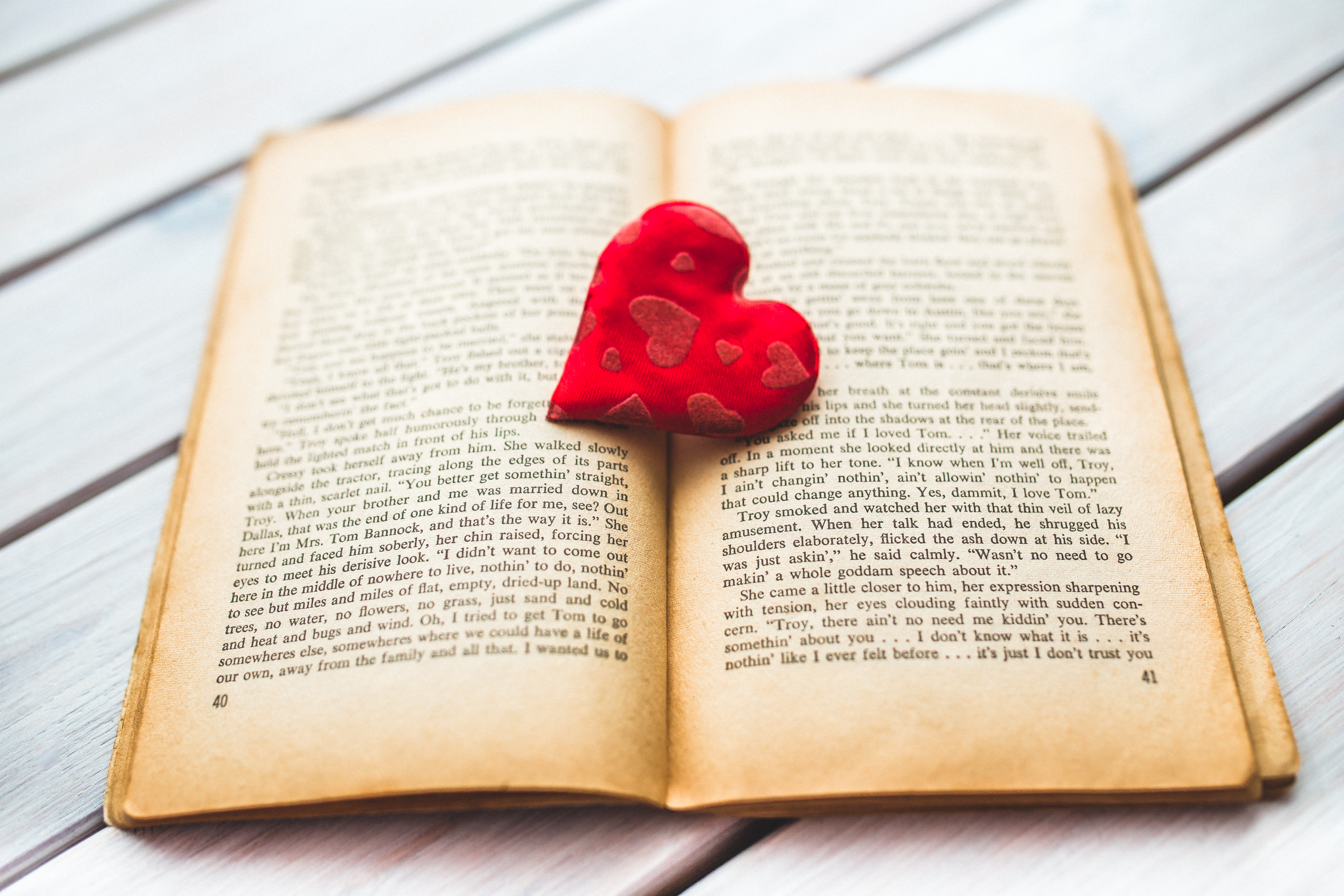 FreeUse - Red heart on a old opened book II high quality photo