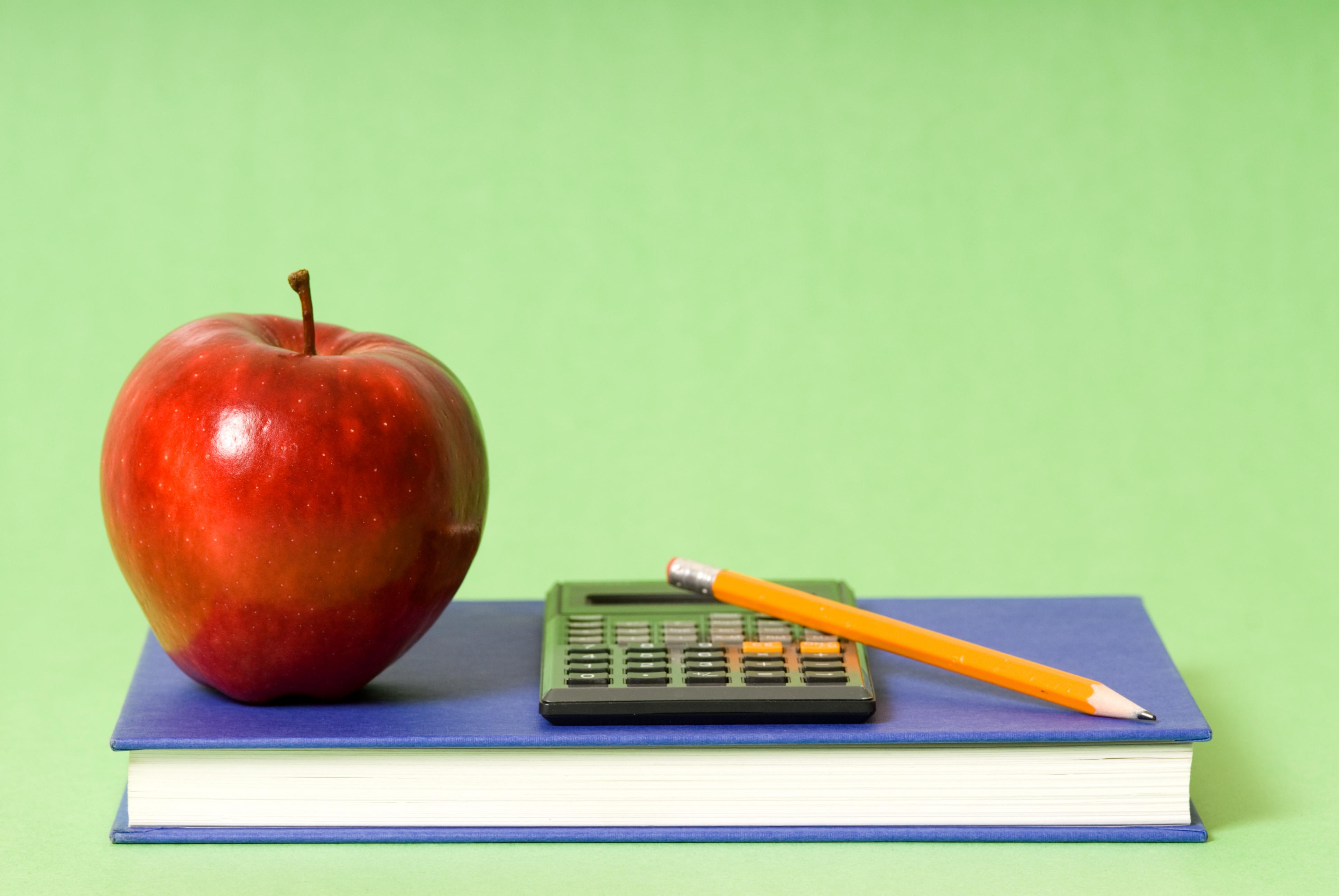 Book, apple, pencil and calculator - basic school stuff