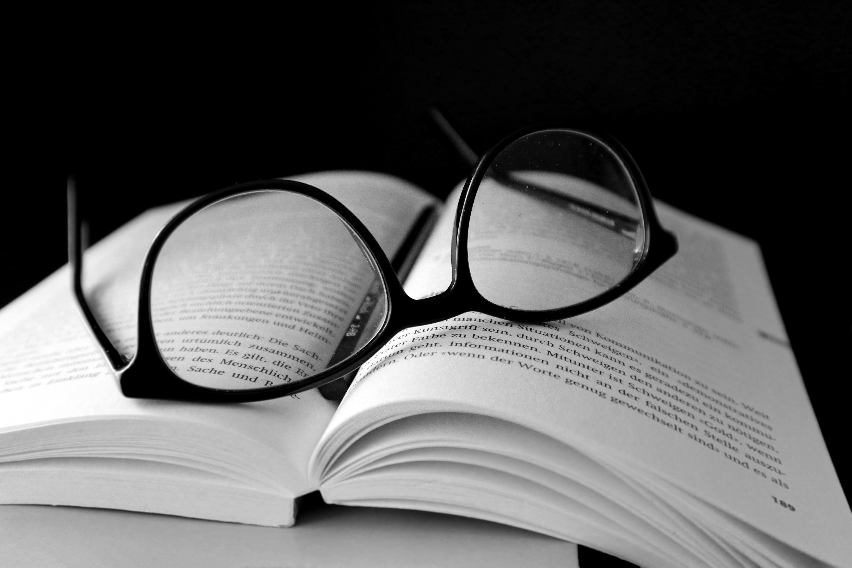 Black Framed Wayfarer Eyeglasses on Book · Free Stock Photo