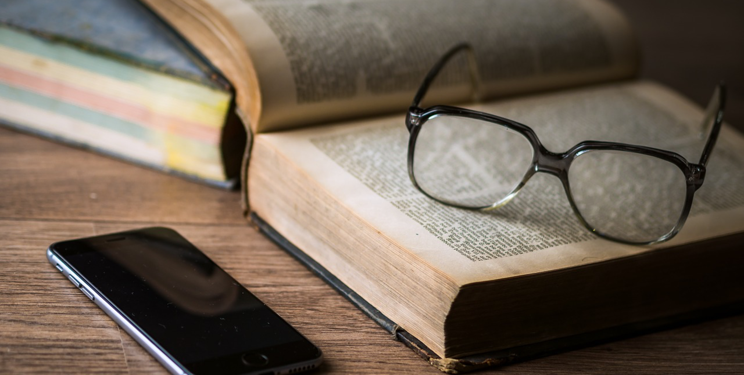 Open book, glasses, and phone – Gregg Pollack's Official Blog