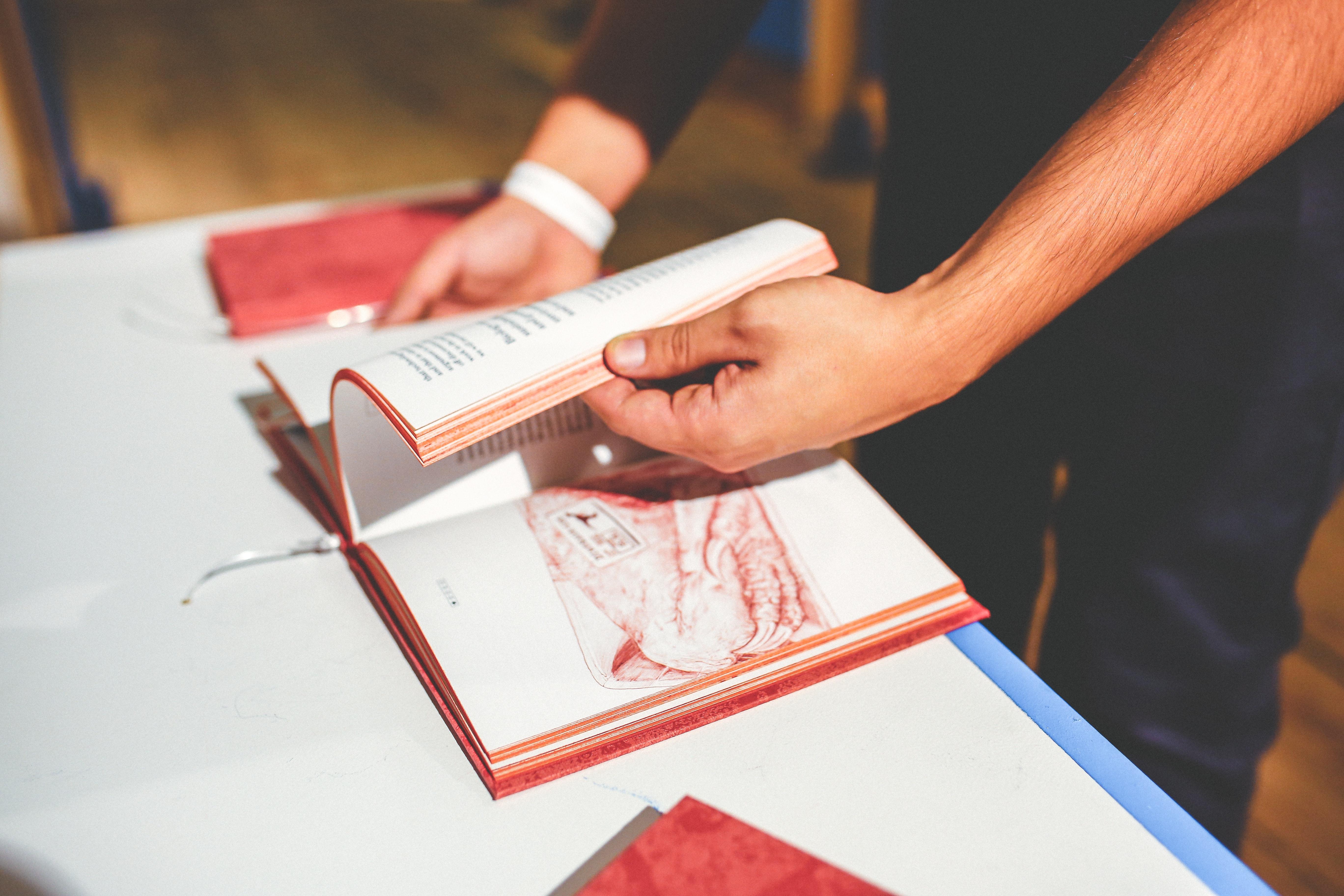 Book in men's hands photo
