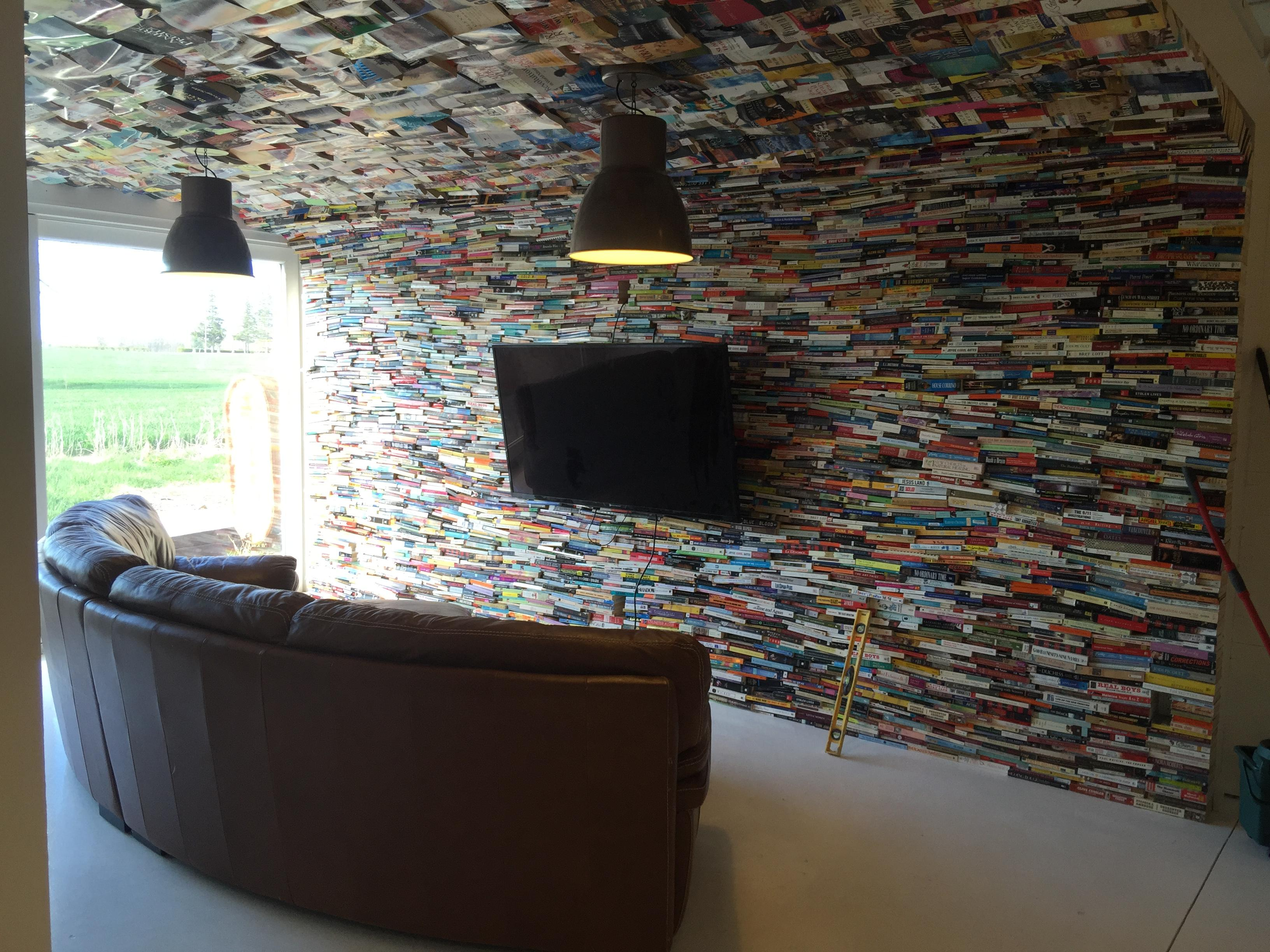 I attached 4000 books to my new living room wall and ceiling ...