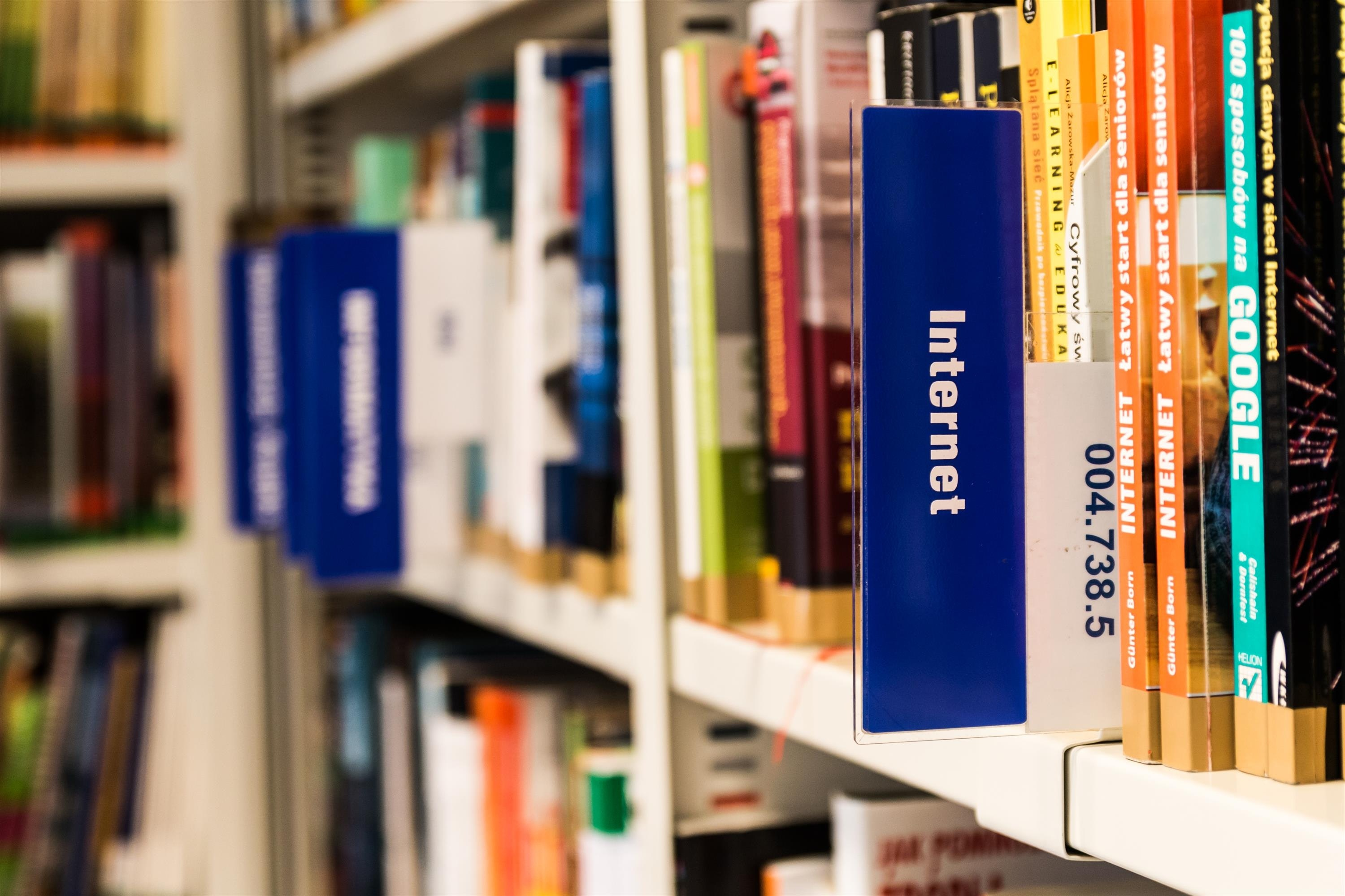 Books on shelf in library photo
